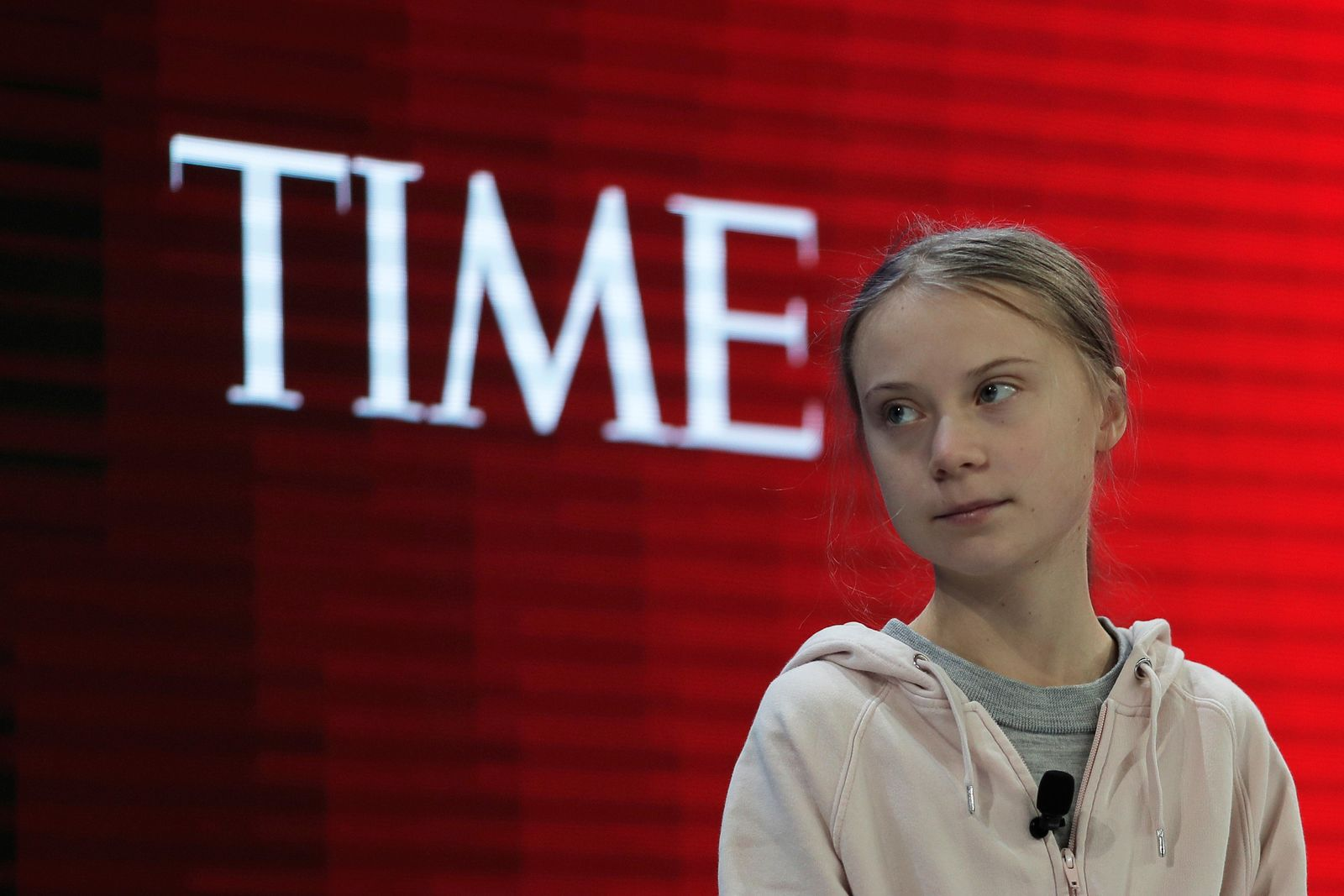 Swedish environmental activist Greta Thunberg takes her seat prior to the opening session of the World Economic Forum in Davos, Switzerland, Tuesday, Jan. 21, 2020. The 50th annual meeting of the forum will take place in Davos from Jan. 20 until Jan. 24, 2020. (AP Photo/Markus Schreiber)