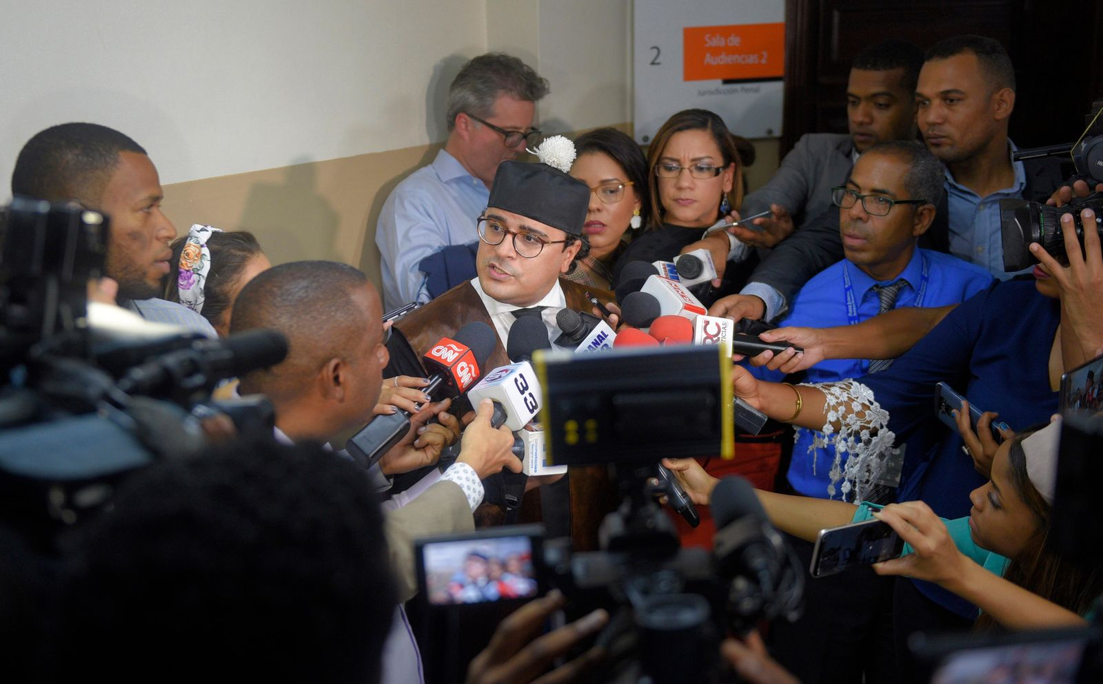 Lawyer José Martínez Hoepelman, who represents former Boston Red Sox slugger David Ortiz, speaks to the press outside court in Santo Domingo, Dominican Republic, Monday, June 17, 2019. Ortiz was shot in the back at a bar in the Dominican Republic on Sunday, June 9. (AP Photo/Roberto Guzman)