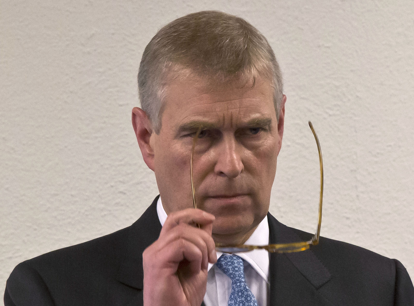 FILE - In this file photo dated Thursday, Jan. 22, 2015, Britain's Prince Andrew, puts on his glasses prior to his speech to business leaders during a reception at the sideline of the World Economic Forum in Davos.{ } (AP Photo/Michel Euler, FILE)