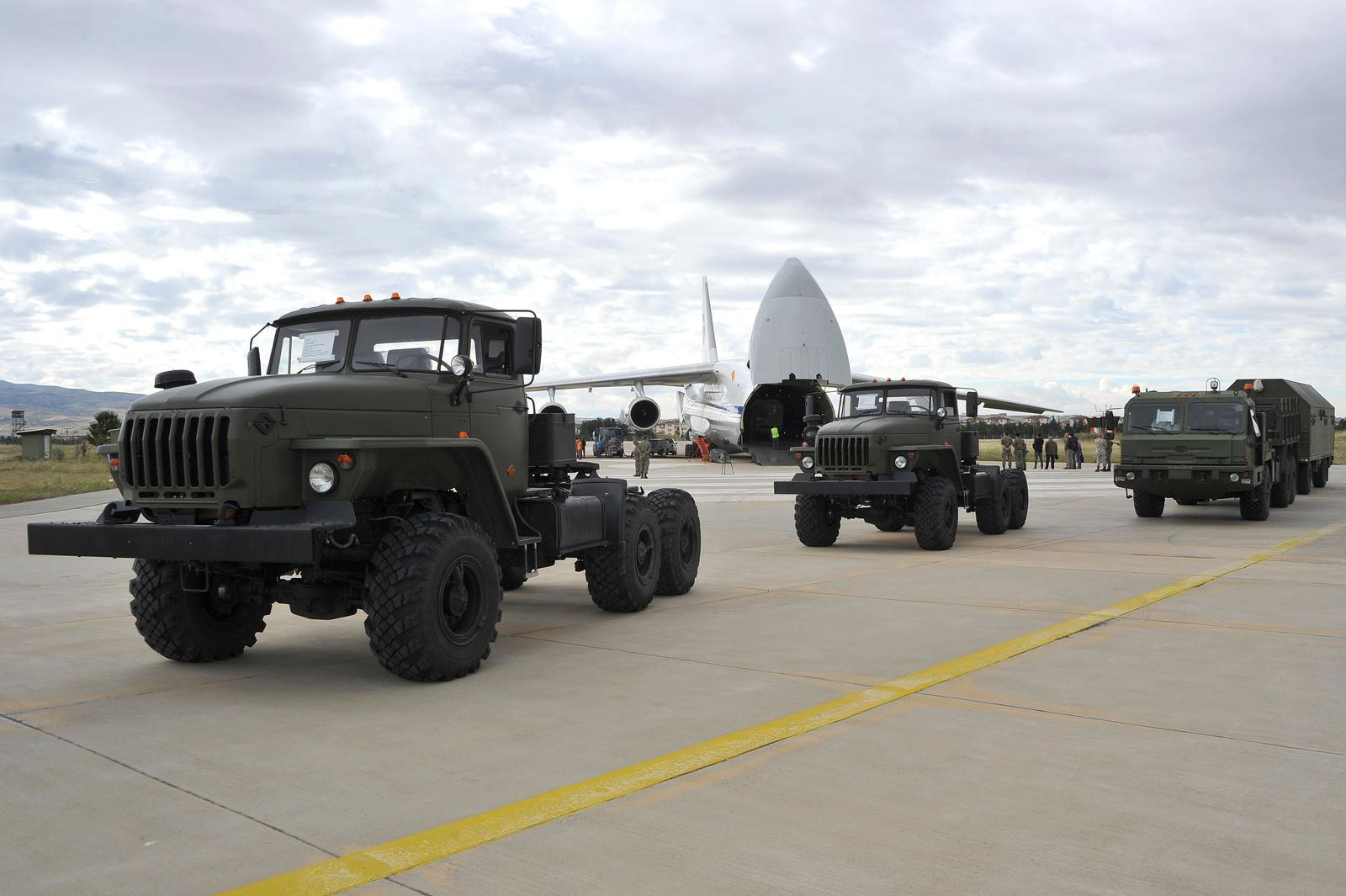 Military vehicles and equipment, parts of the S-400 air defense systems, are seen on the tarmac, after they were unloaded from a Russian transport aircraft, at Murted military airport in Ankara, Turkey, Friday, July 12, 2019. (Turkish Defence Ministry via AP, Pool)