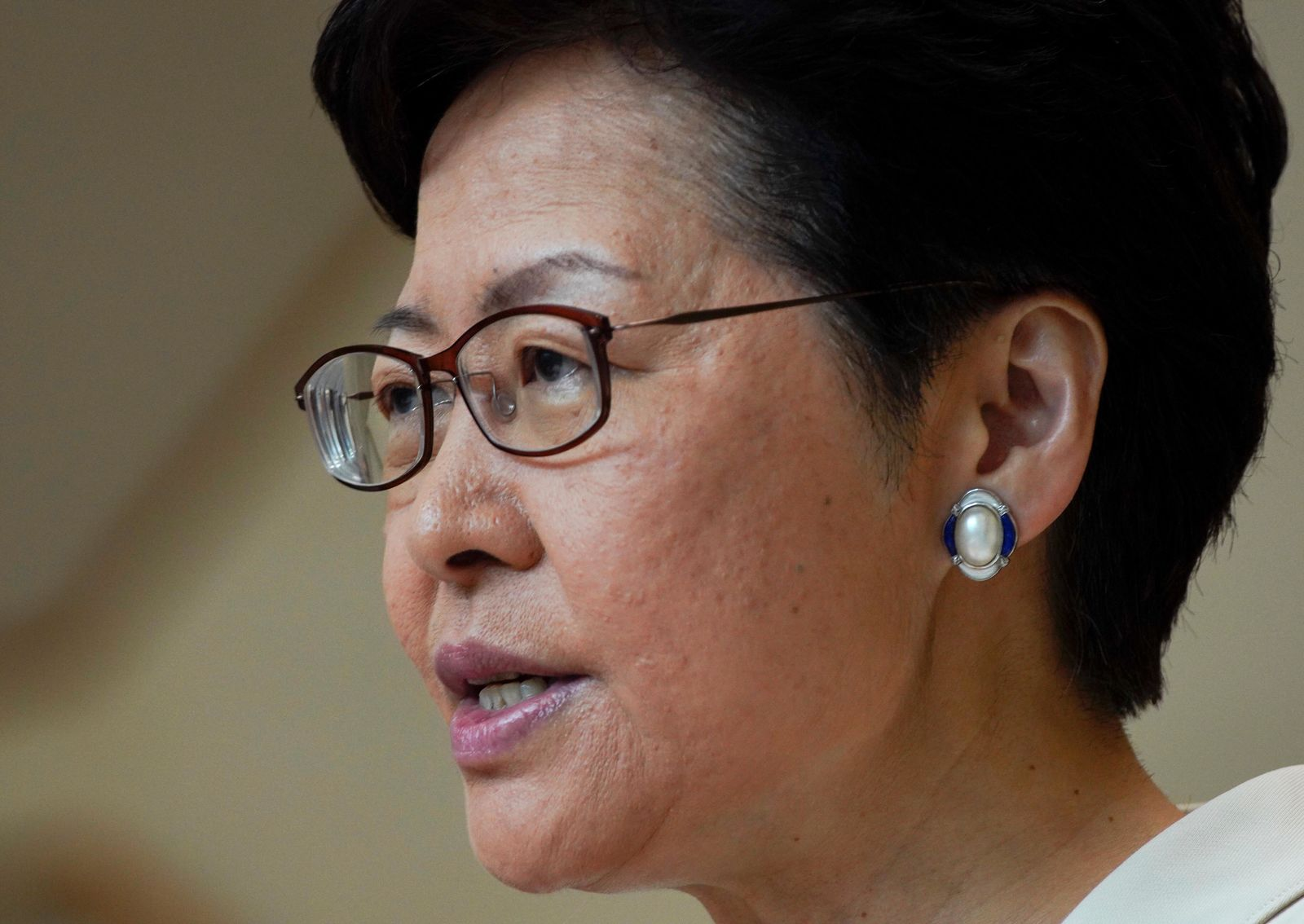 Hong Kong Chief Executive Carrie Lam speaks to reporters' during a press conference at the government building in Hong Kong, Tuesday, Sept. 17, 2019. (AP Photo/Vincent Yu)