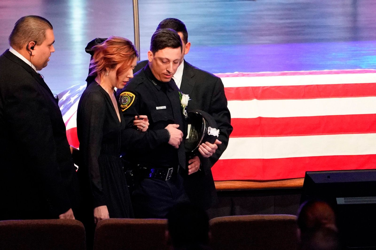 Widow Bethany Elise Brewster is escorted into the church sanctuary for the funeral of her husband, Houston Police Sgt. Christopher Brewster, Thursday, Dec. 12, 2019, at Grace Church Houston in Houston. Brewster, 32, was gunned down Saturday evening, Dec. 7, while responding to a domestic violence call in Magnolia Park. Police arrested 25-year-old Arturo Solis that night in the shooting death. Solis faces capital murder charges. (Melissa Phillip/Houston Chronicle via AP, Pool)