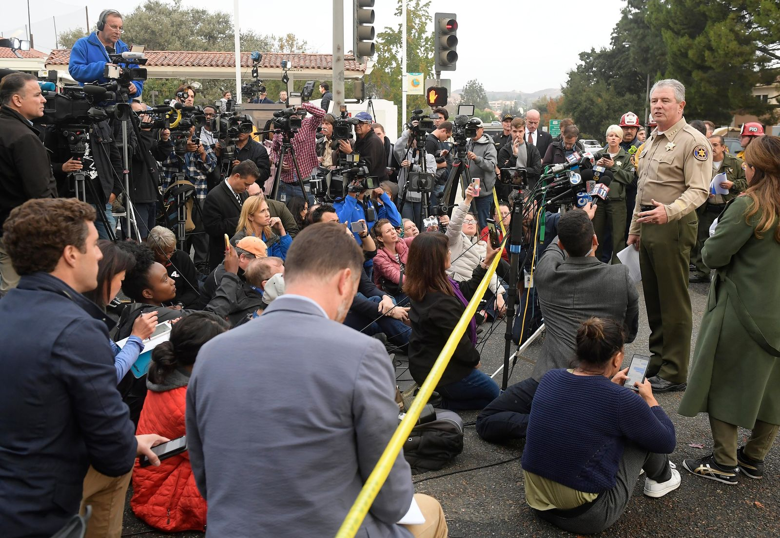 Ventura County Sheriff Geoff Dean speaks to reporters near the scene in Thousand Oaks, Calif., on Thursday, Nov. 8, 2018, where a gunman opened fire the previous night inside a country dance bar crowded with hundreds of people. Officials say the suspect is dead inside the bar. (AP Photo/Mark J. Terrill)