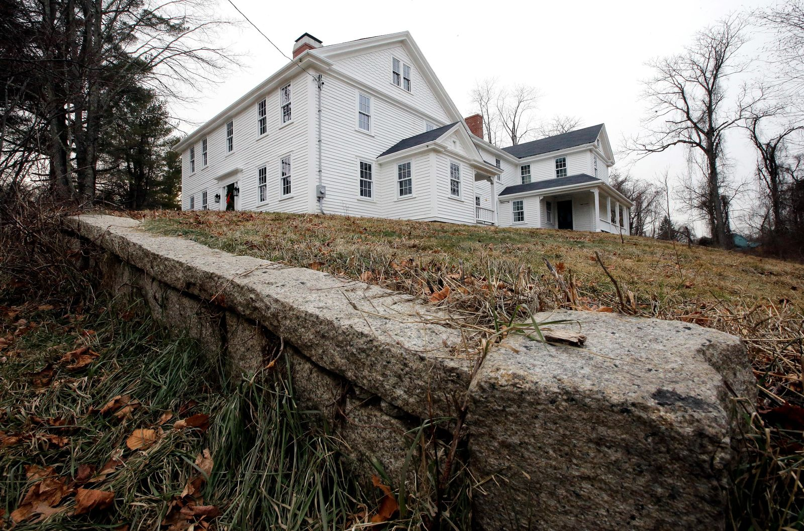 In this Thursday, Dec. 13, 2018 photo a wall stands near the home where Sarah Clayes lived, in Framingham, Mass., after leaving Salem, Mass., following the 1692 witch trials.  Clayes was jailed during the witch trials but was freed in 1693 when the hysteria died down. (AP Photo/Steven Senne)