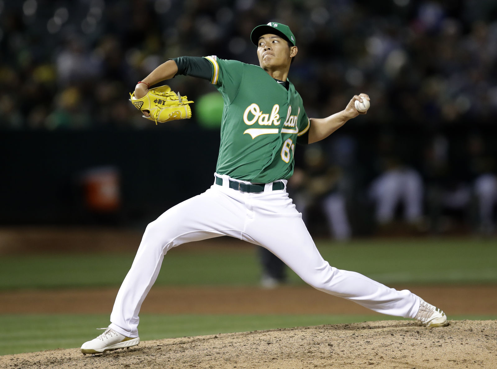 Oakland Athletics pitcher Wei-Chung Wang works against the Seattle Mariners during the seventh inning of a baseball game Friday, June 14, 2019, in Oakland, Calif. (AP Photo/Ben Margot)