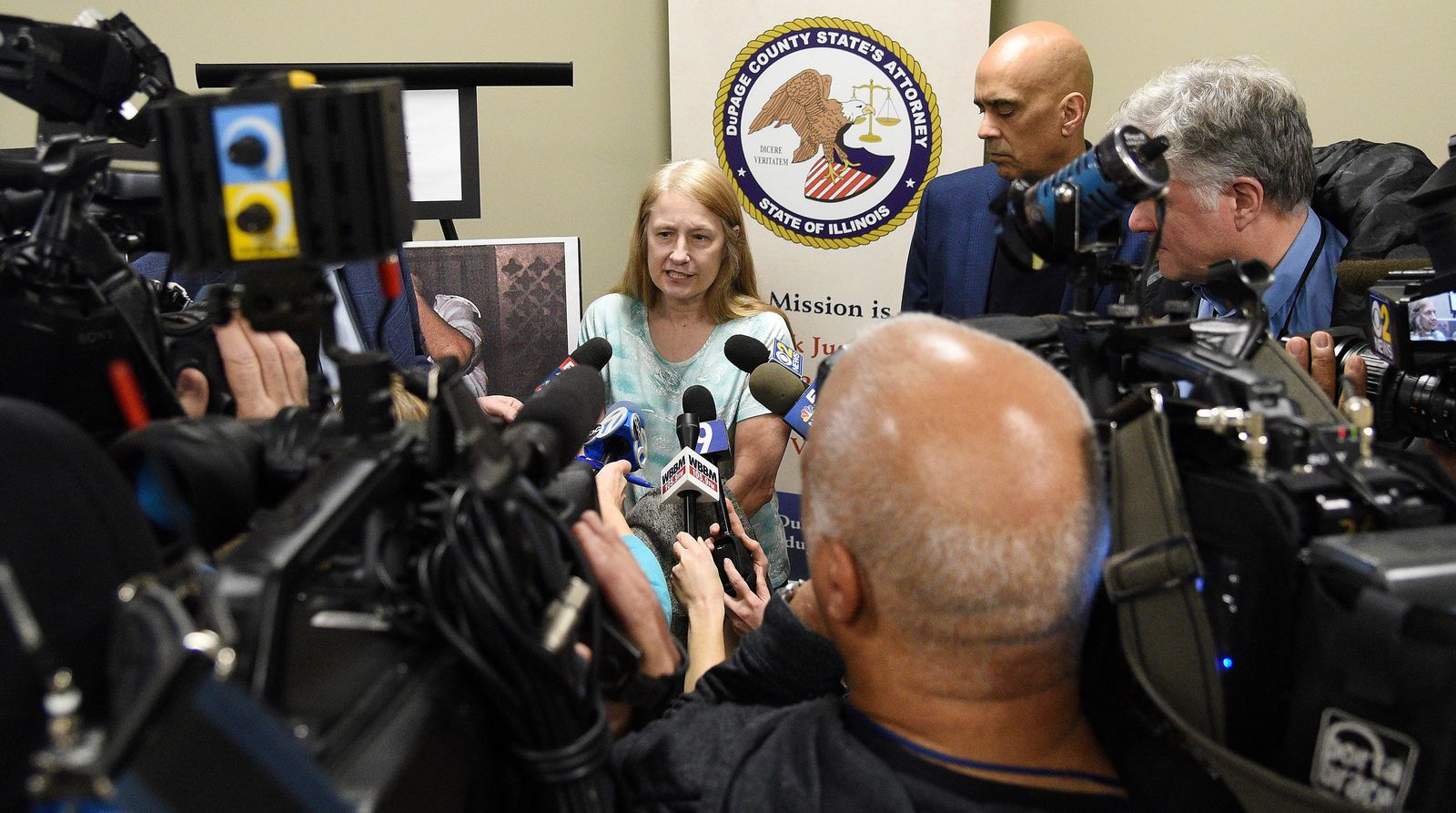Cindy Evans, a friend of murder victim Pamela Maurer, speaks to the media following a news conference in Wheaton, Ill., Monday, Jan. 13, 2020. A suspected serial killer strangled Maurer, a suburban Chicago teenage girl, in 1976 and likely killed another woman just days before she was to testify in court that he raped her, police said Monday. (Rick West/Daily Herald via AP)