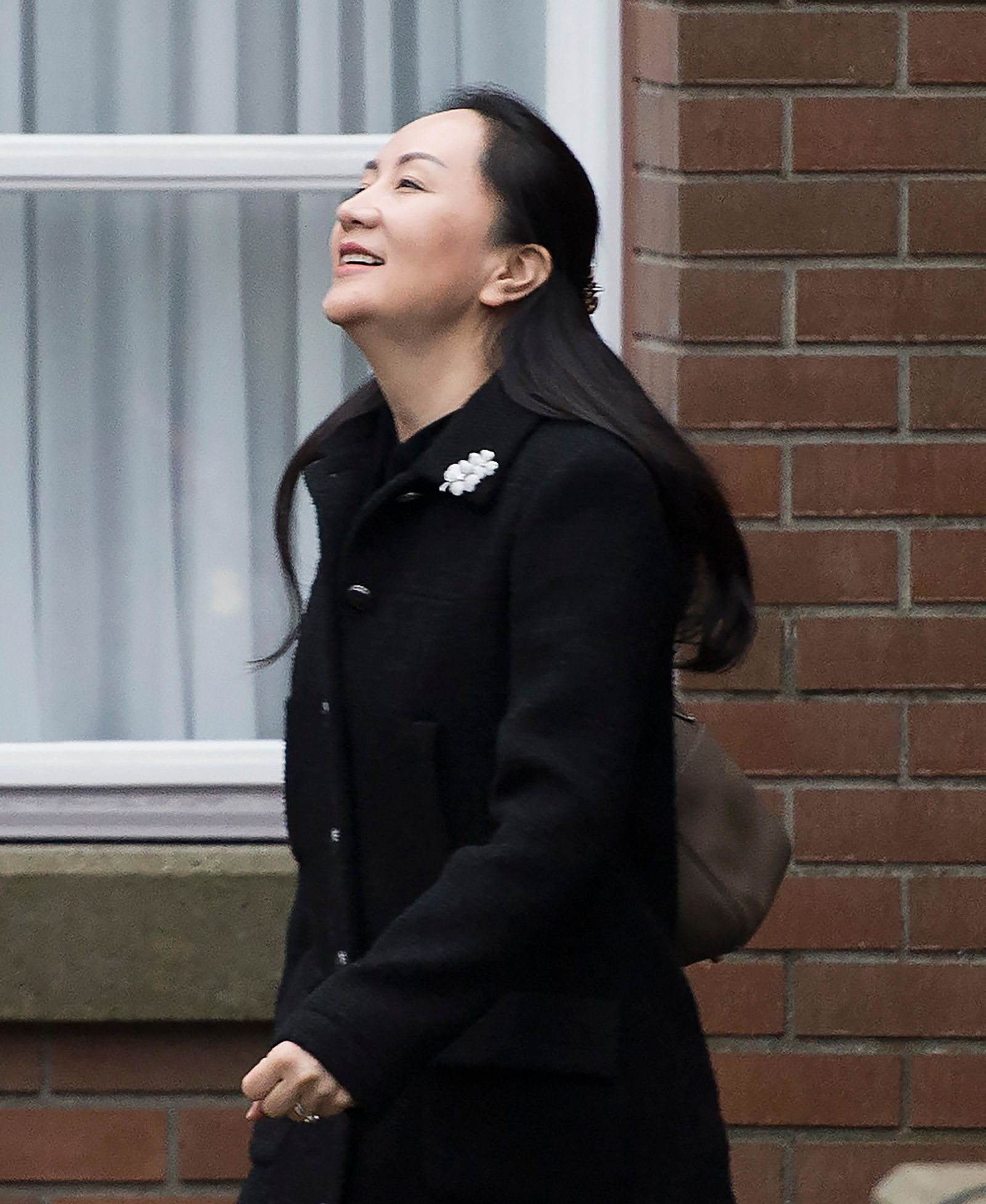 Meng Wanzhou, chief financial officer of Huawei leaves her home in Vancouver, Monday, January, 20, 2020. (Jonathan Hayward/The Canadian Press via AP)