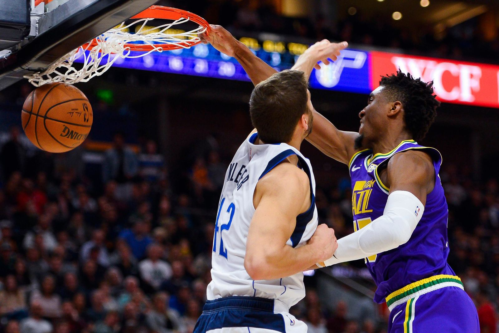 Utah Jazz guard Donovan Mitchell (45) dunks over Dallas Mavericks forward Maximilian Kleber (42) during the first half of an NBA basketball game Wednesday, Nov. 7, 2018, in Salt Lake City. (AP Photo/Alex Goodlett)