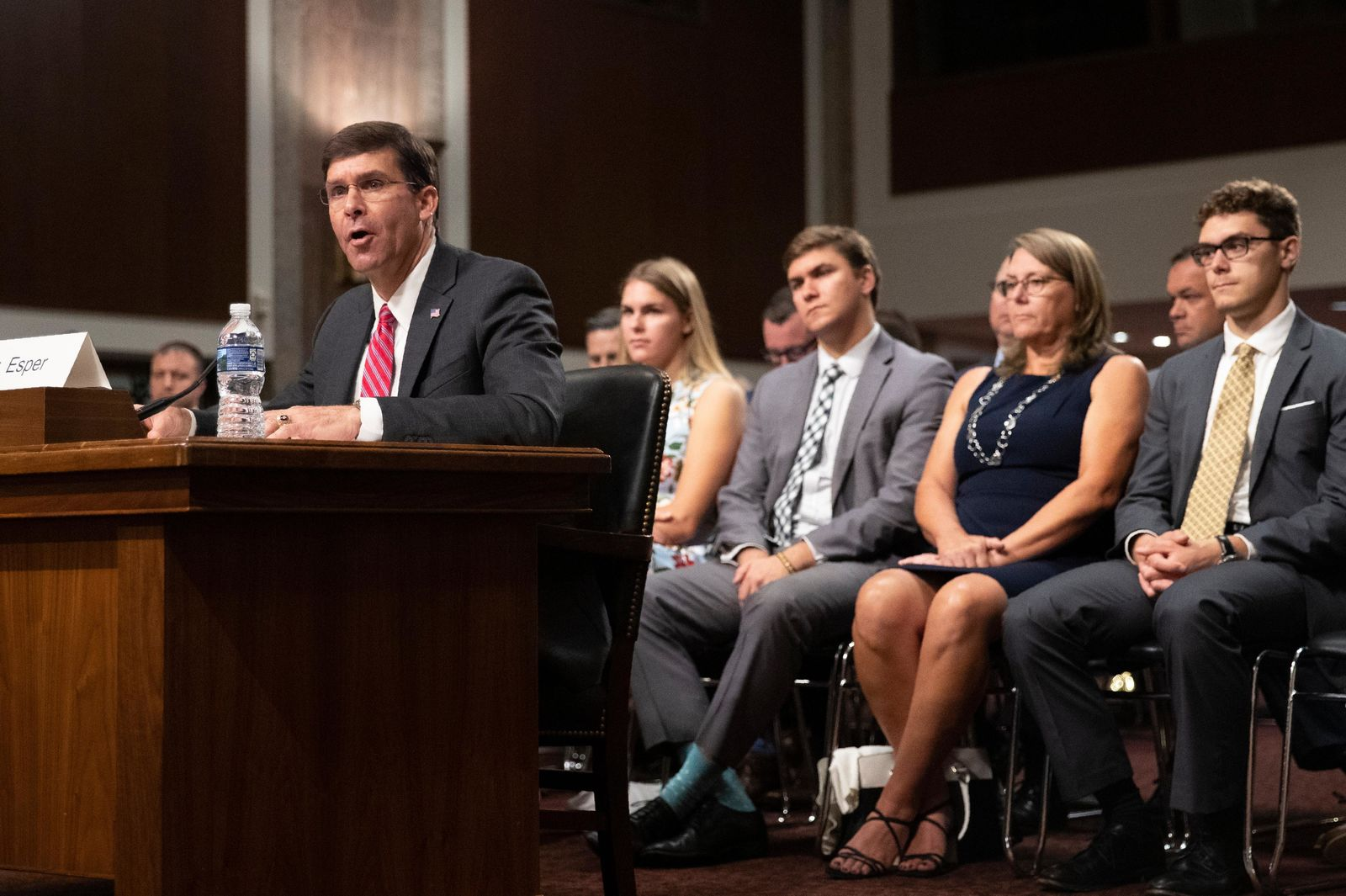 Secretary of the Army and Secretary of Defense nominee Mark Esper accompanied by his family, from back left, daughter Kate Esper, son Luke Esper, his wife Leah Esper and son John Esper, testifies before a Senate Armed Services Committee confirmation hearing on Capitol Hill in Washington, Tuesday, July 16, 2019. (AP Photo/Manuel Balce Ceneta)