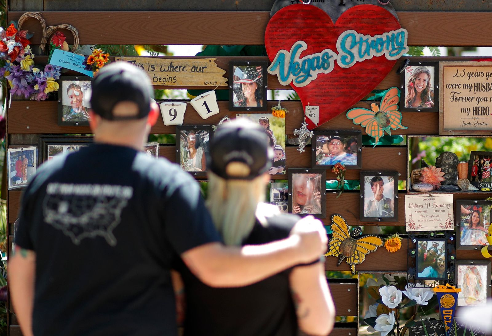People visit a memorial garden for victims of a mass shooting in Las Vegas, Thursday, Oct. 3, 2019, in Las Vegas. (AP Photo/John Locher)