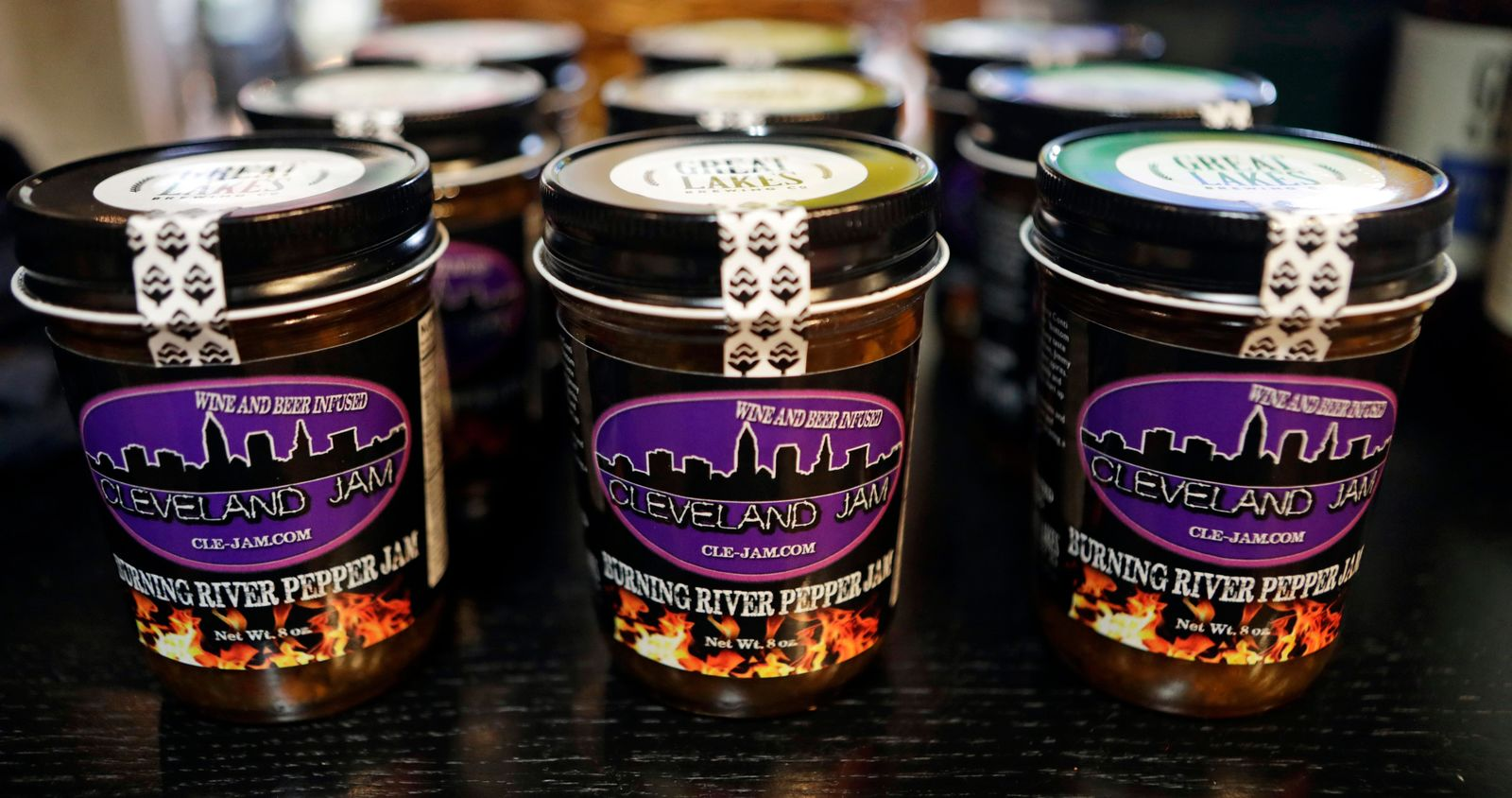 "Burning River Pepper Jam is displayed on a shelf at the Great Lakes Brewing Company gift shop, Monday, June 17, 2019, in Cleveland. The ""burning river"" in the jam's name is inspired by the Cuyahoga River's most famous fire. (AP Photo/Tony Dejak)"
