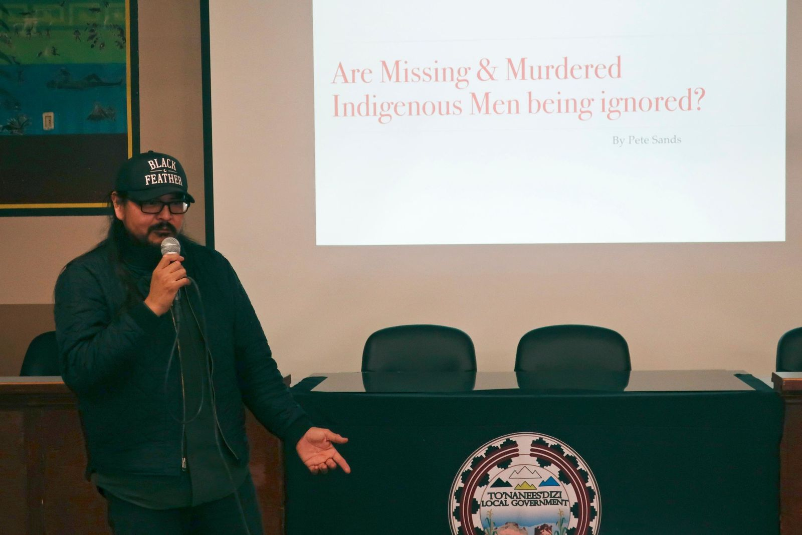 In this Jan. 14, 2020, photo, Navajo musician and filmmaker Pete Sands talks about missing indigenous men at a forum in Tuba City, Ariz. People were gathered to talk not about women and girls who have disappeared or been killed, but men. It's a shift from a larger movement focused on Native American women, who face some of the nation's highest homicide, sexual violence and domestic abuse rates. (AP Photo/Felicia Fonseca)