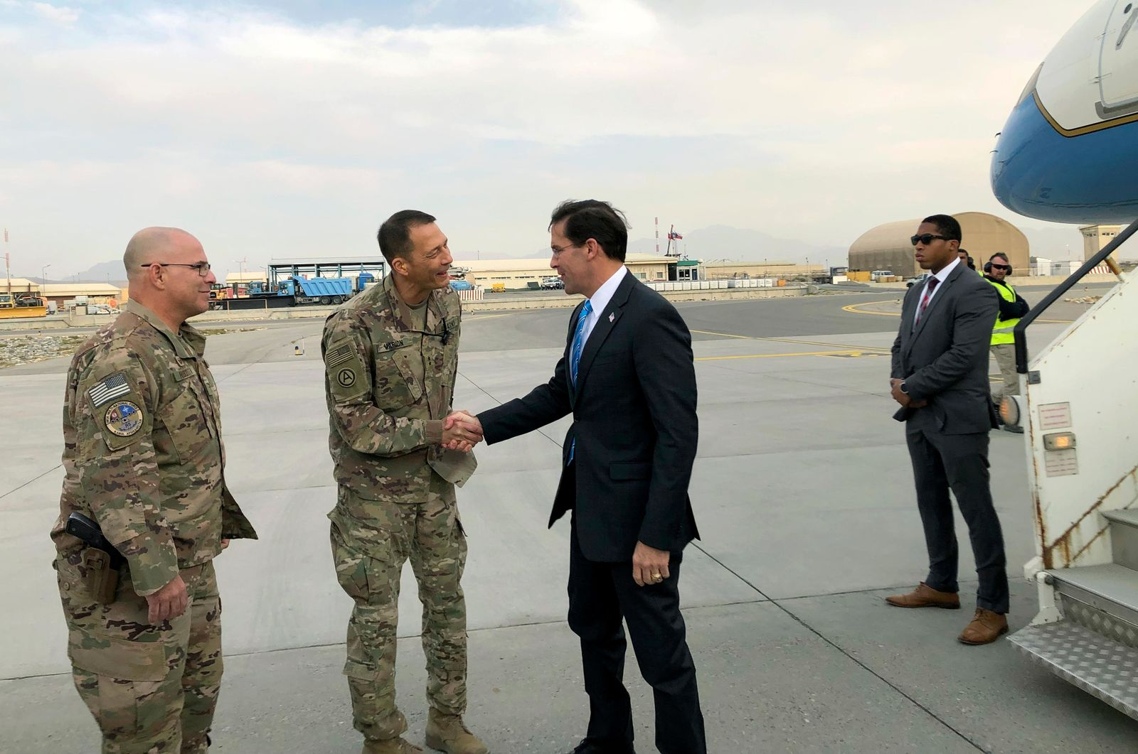 U.S. Defense Secretary Mark Esper, center, is greeted by U.S. military personnel upon arriving in Kabul, Afghanistan, Sunday, Oct. 20, 2019.{ }