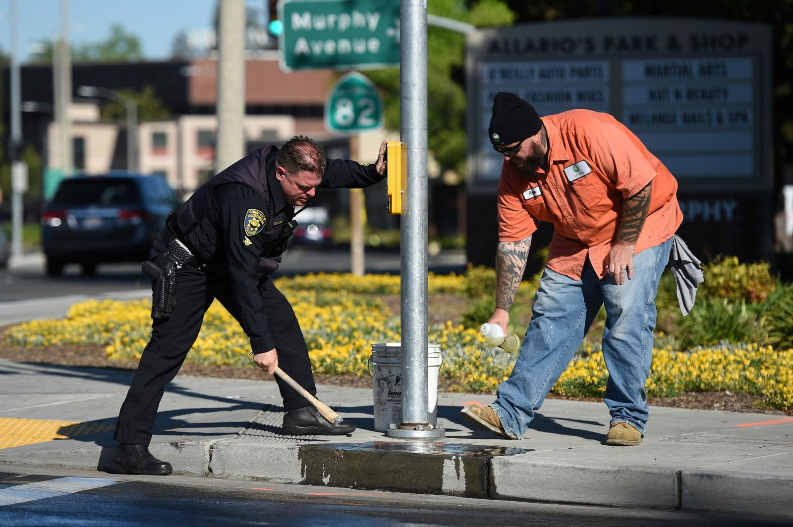 Police and road crews work to clean up the scene after a car crash at the intersection of El Camino Real and Sunnyvale Road in Sunnyvale, Calif., on Wednesday, April 24, 2019. Investigators are working to determine the cause of the crash in Northern California that injured several pedestrians on Tuesday evening. Authorities say the driver of the car was taken into custody after he appeared to deliberately plow into the group. (AP Photo/Cody Glenn)