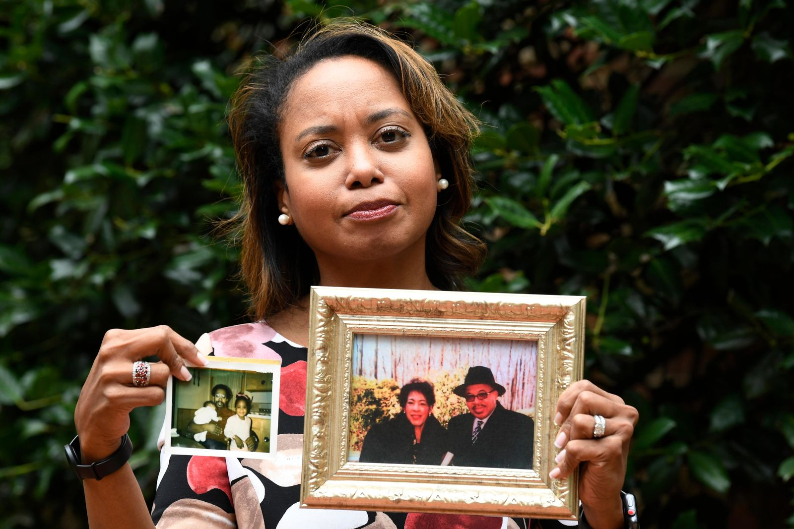 "In this Sept. 6, 2019, photo, Donna Cryer holds up family photos that include her father Roland Henry, as she poses for a photo in Washington. When her father died, she tried to donate his organs, yet the local organ collection agency said no, without talking to the family or providing a reason. ""It was devastating to be told there was nothing they considered worthy of donation. Nada. Not a kidney, not a liver, not tissue,"" recalled Donna Cryer, president of the nonprofit Global Liver Institute and herself a recipient of a liver transplant. (AP Photo/Susan Walsh)"