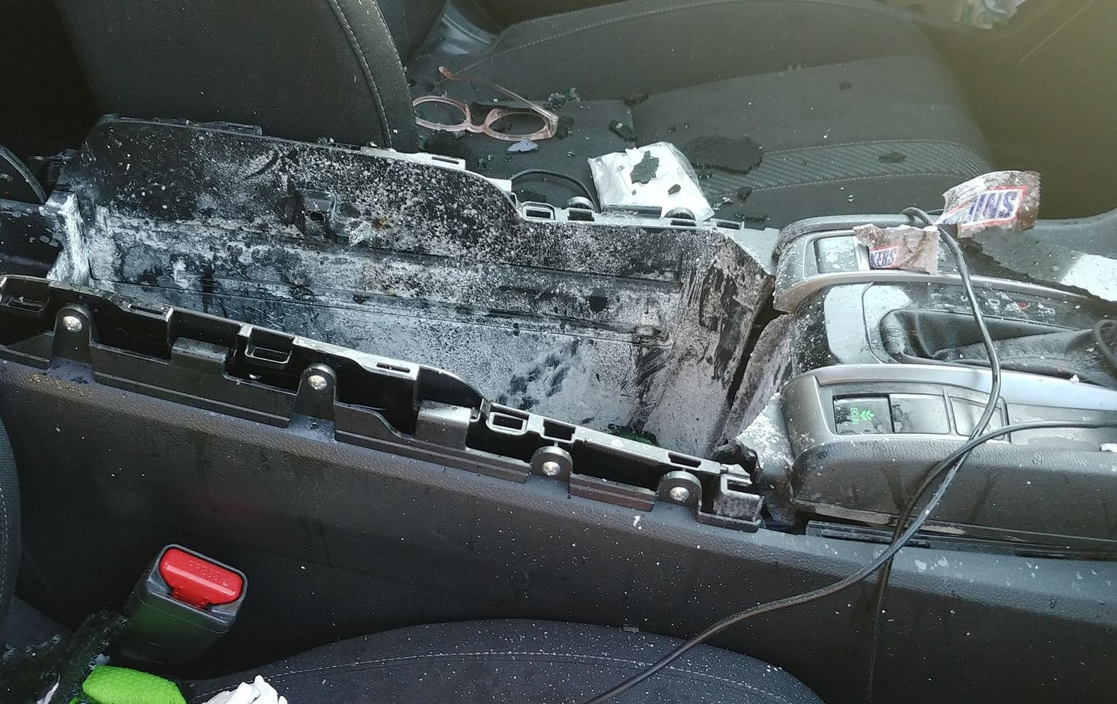The can blew the console cover off of its hinges, shot through the sunroof, and went high enough in the air that it landed about 50 feet away. (Christine Bader Debrecht)
