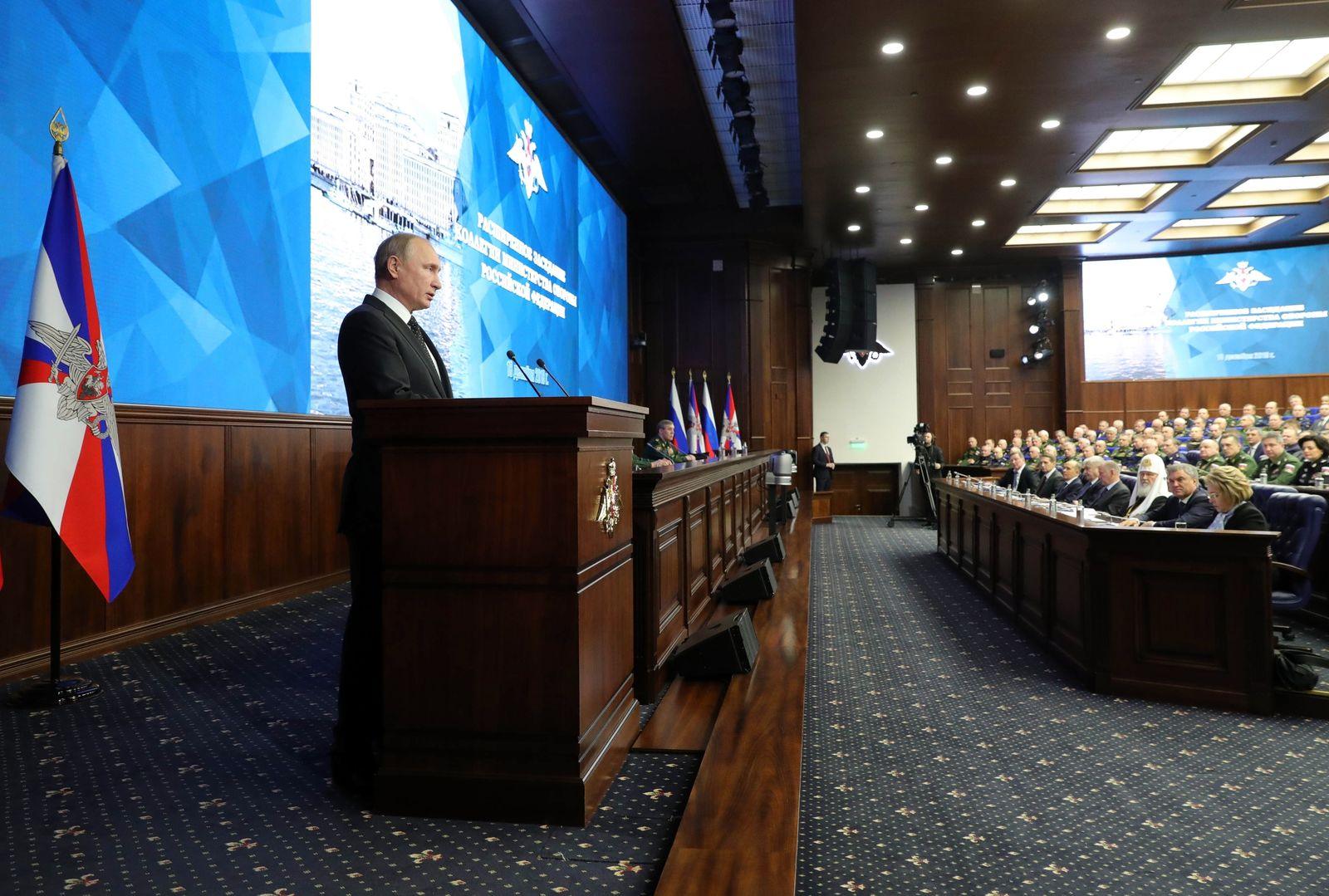 Russian President Vladimir Putin makes an address during a meeting in the Russian Defense Ministry's headquarters in Moscow, Russia, Tuesday, Dec. 18, 2018.{ } (Mikhail Klimentyev, Sputnik, Kremlin Pool Photo via AP)