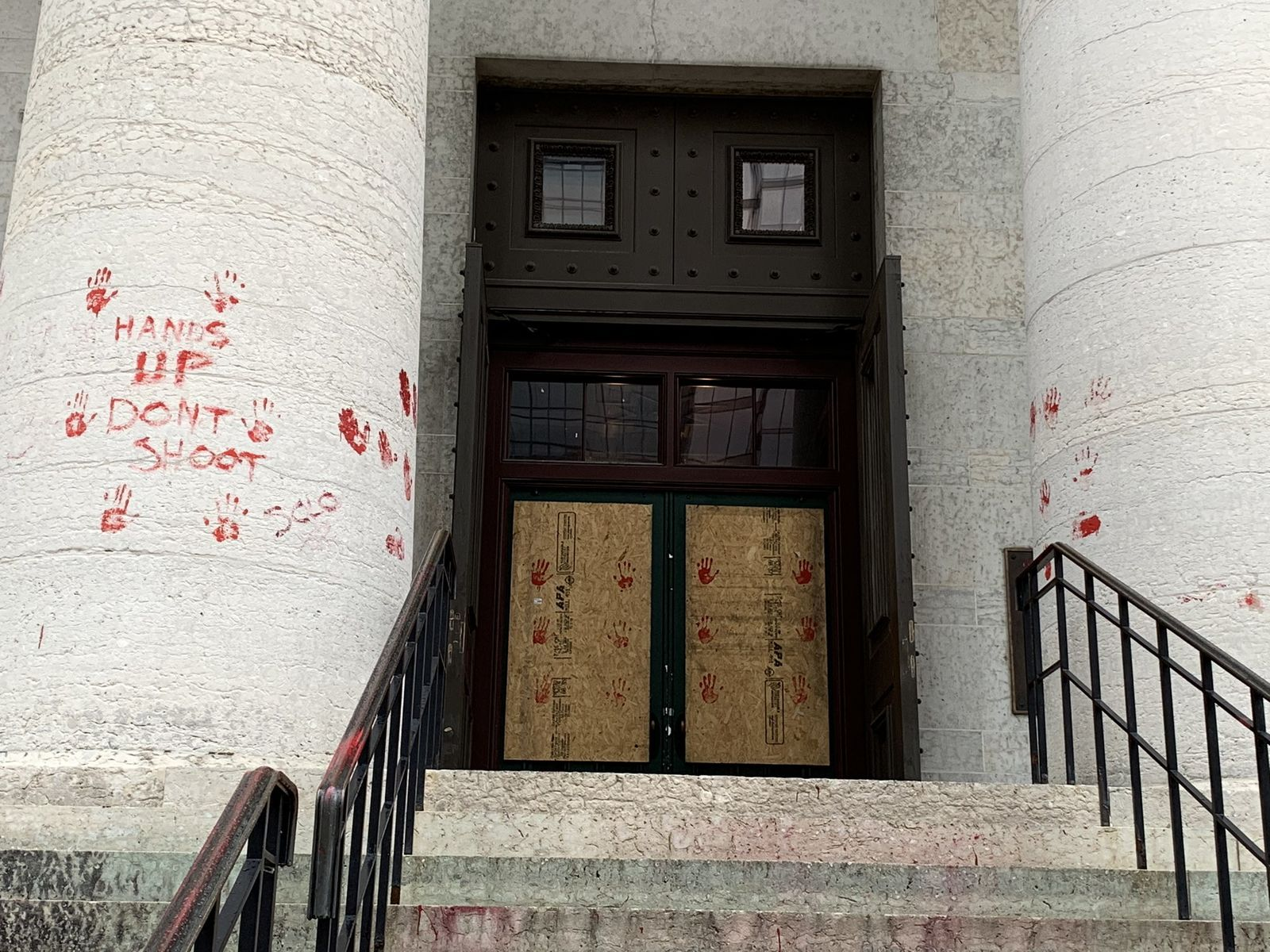 A group of protesters painted red handprints on the steps and walls of the Ohio Statehouse. (WSYX/WTTE)