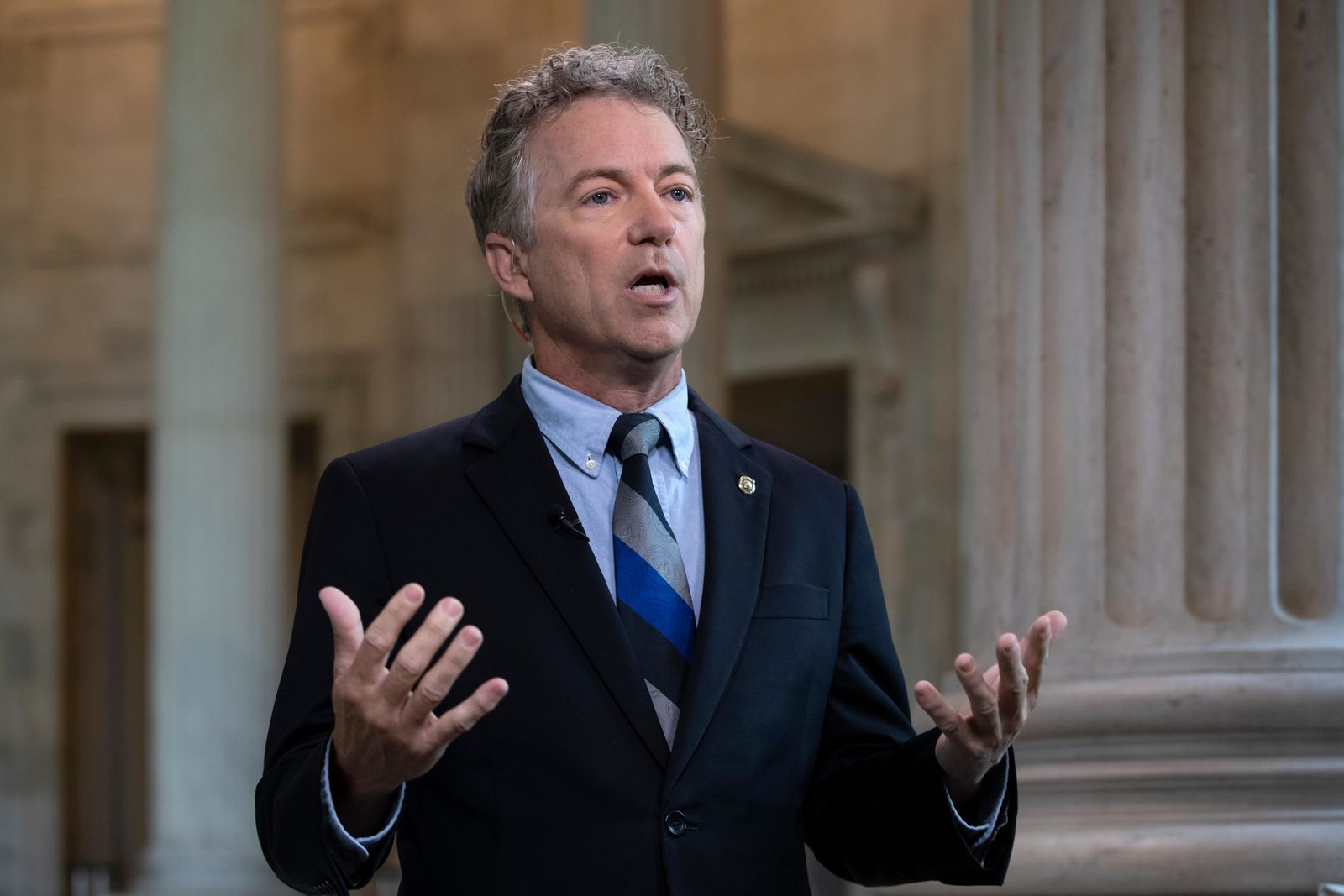 "FILE - In this July 17, 2018, file photo, Sen. Rand Paul, R-Ky., speaks during a television interview as he defends President Donald Trump and his Helsinki news conference with Russian President Vladimir Putin on Capitol Hill in Washington. Two years into President Donald Trump's administration, the president's allies in Congress are quietly trying to influence and even reshape his ""America First"" foreign policy agenda. (AP Photo/J. Scott Applewhite, File)"