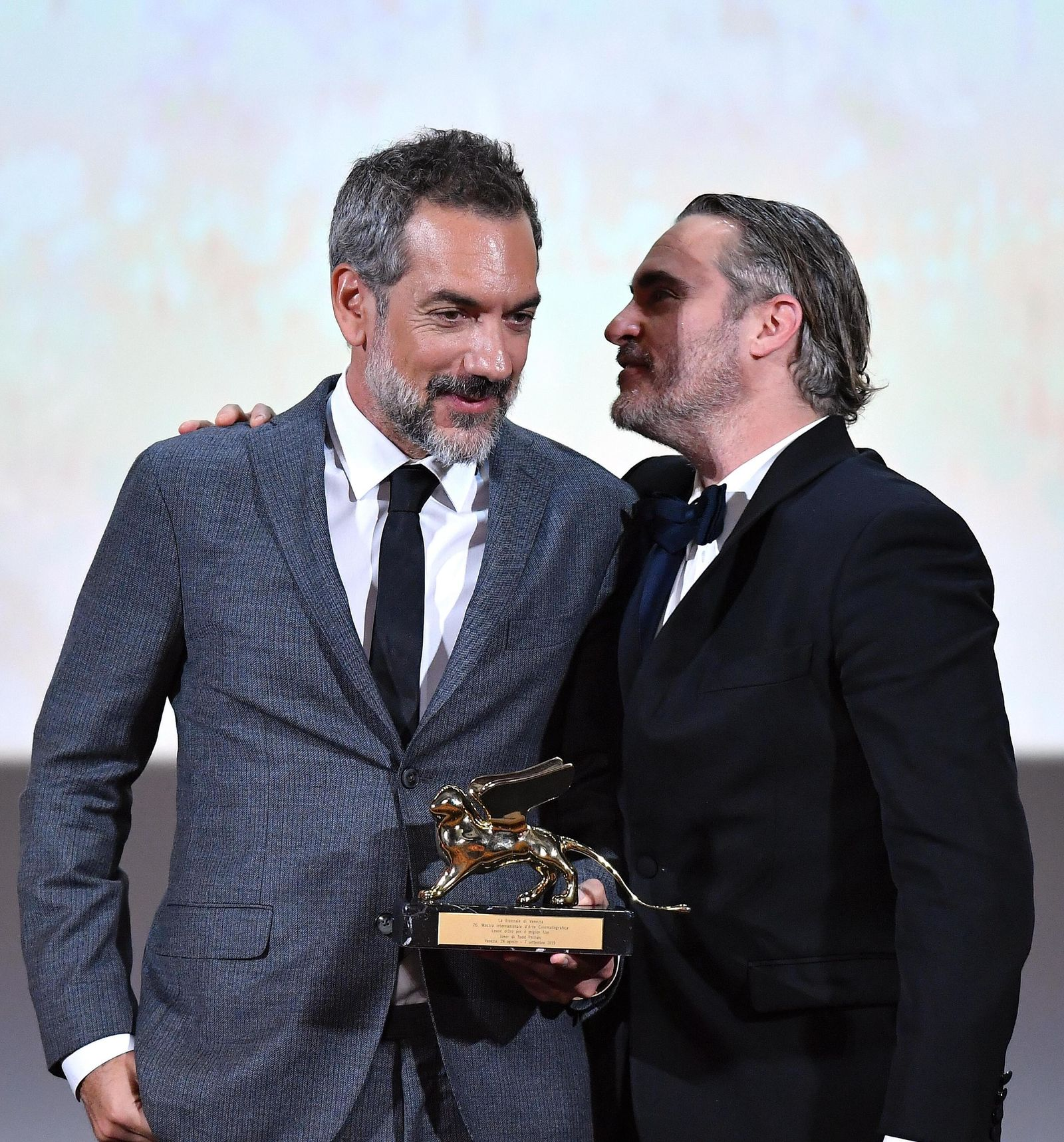 US actor Joaquin Phoenix, right, and US director, Todd Phillips, hold the Golden Lion award for the movie 'Joker' i during the awarding ceremony of the 76th annual Venice International Film Festival in Venice, Italy, Saturday, Sept. 7, 2019. (Ettore Ferrari/ANSA via AP)