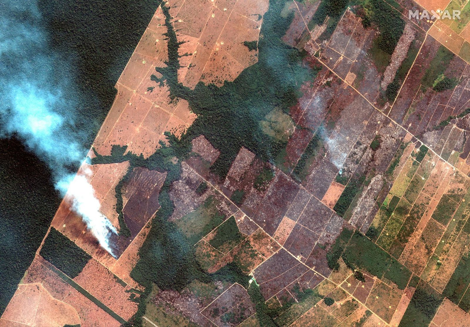 This Aug. 15, 2019 satellite image from Maxar Technologies shows a fire and cleared land southwest of Porto Velho Brazil. Brazil's National Institute for Space Research, a federal agency monitoring deforestation and wildfires, said the country has seen a record number of wildfires this year as of Tuesday, Aug. 20.   (Satellite image ©2019 Maxar Technologies via AP)