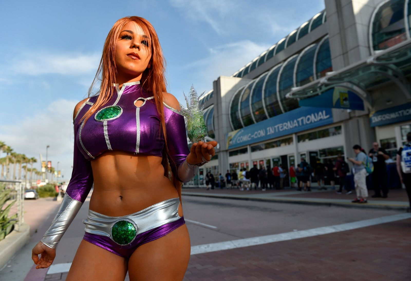 "Emily Escevarria, of San Diego, shows off her costume as Starfire from the ""Teen Titans Go!"" television series outside Preview Night of the 2018 Comic-Con International at the San Diego Convention Center, Wednesday, July 18, 2018, in San Diego. (Photo by Chris Pizzello/Invision/AP)"