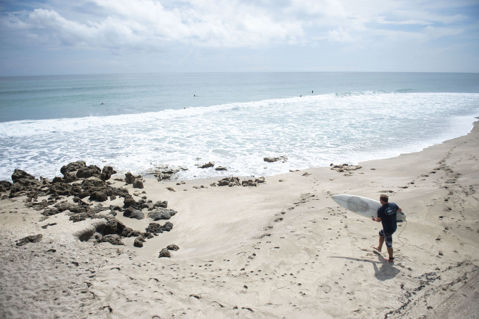Surfers search for waves ahead of Hurricane Dorian on Thursday, Aug. 29, 2019, at Chastain Beach on Hutchinson Island, Fla. (Leah Voss/TCPalm.com via AP)