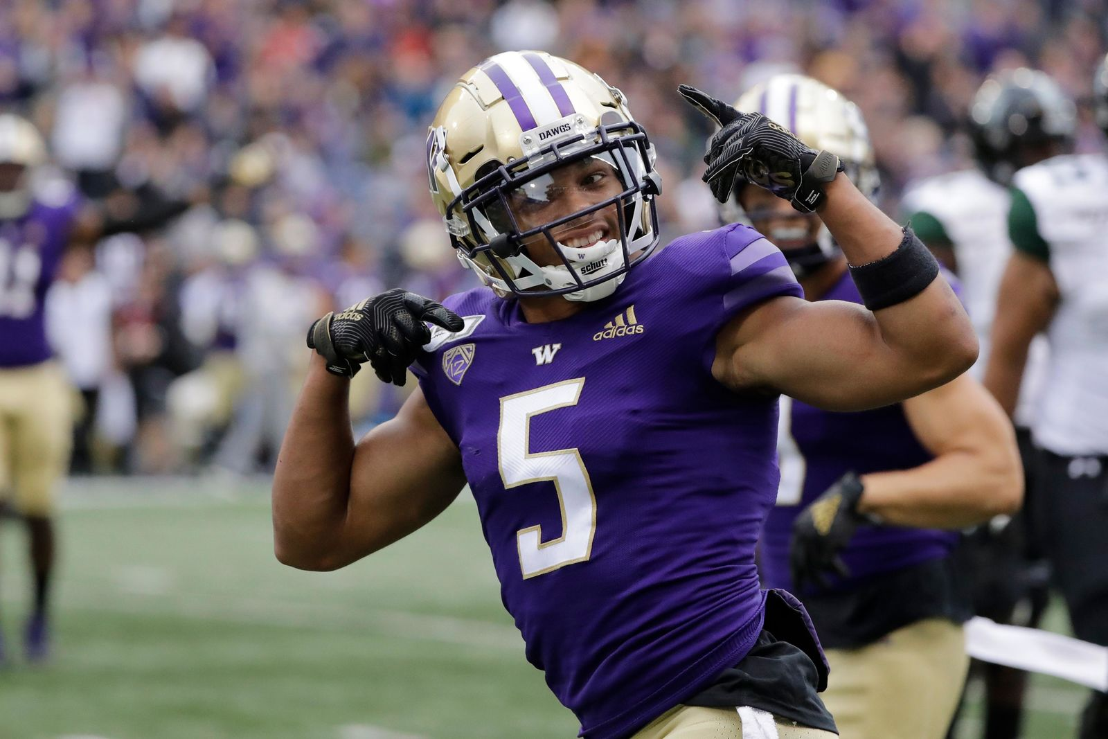 Washington defensive back Myles Bryant celebrates after he intercepted a pass against Hawaii during the first half of an NCAA college football game, Saturday, Sept. 14, 2019, in Seattle. (AP Photo/Ted S. Warren)