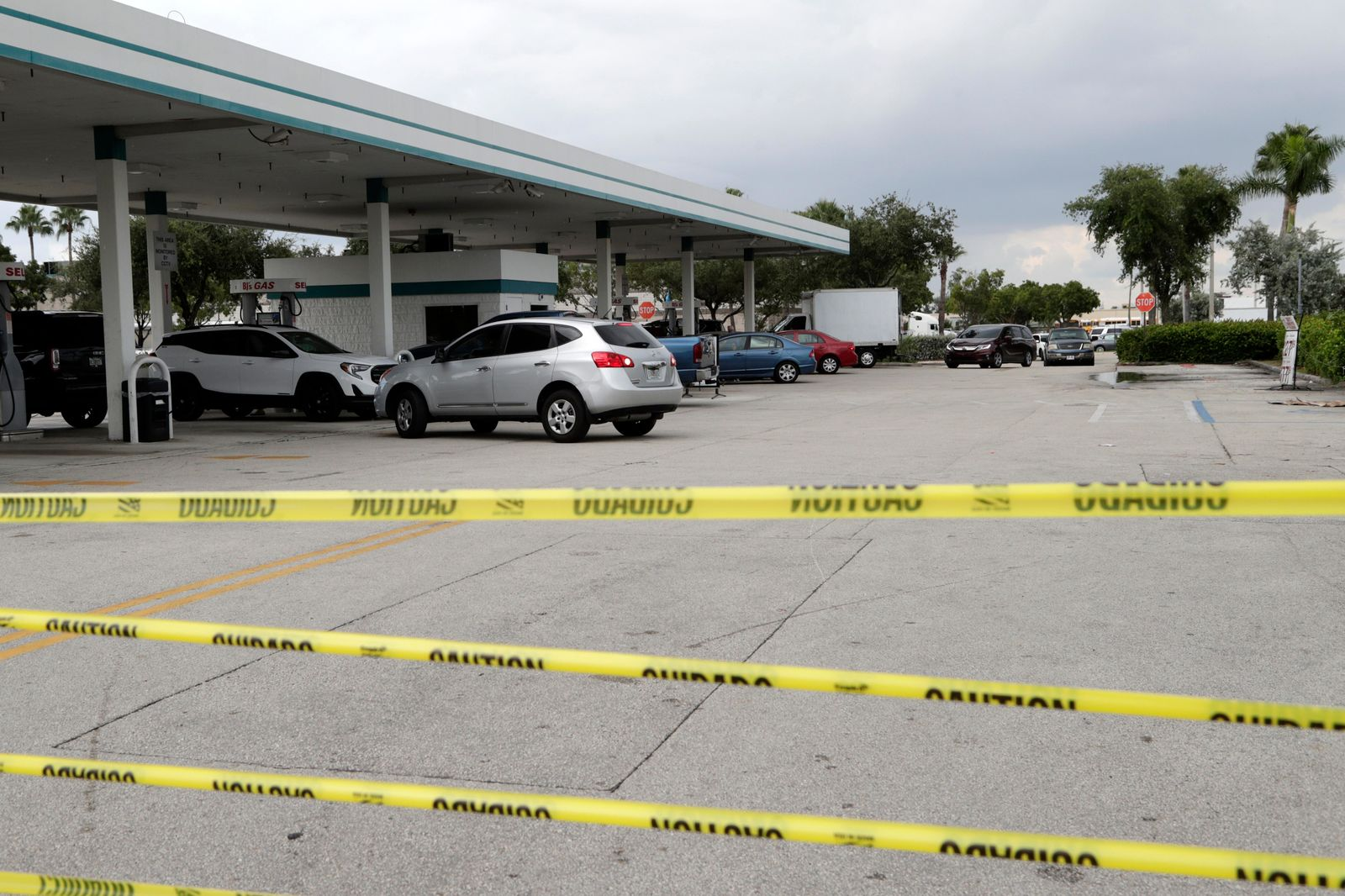 Tape blocks an entrance at BJ's Wholesale Club to control traffic flow as motorists line up for fuel in preparation for Hurricane Dorian, Thursday, Aug. 29, 2019, in Hialeah, Fla. (AP Photo/Lynne Sladky)