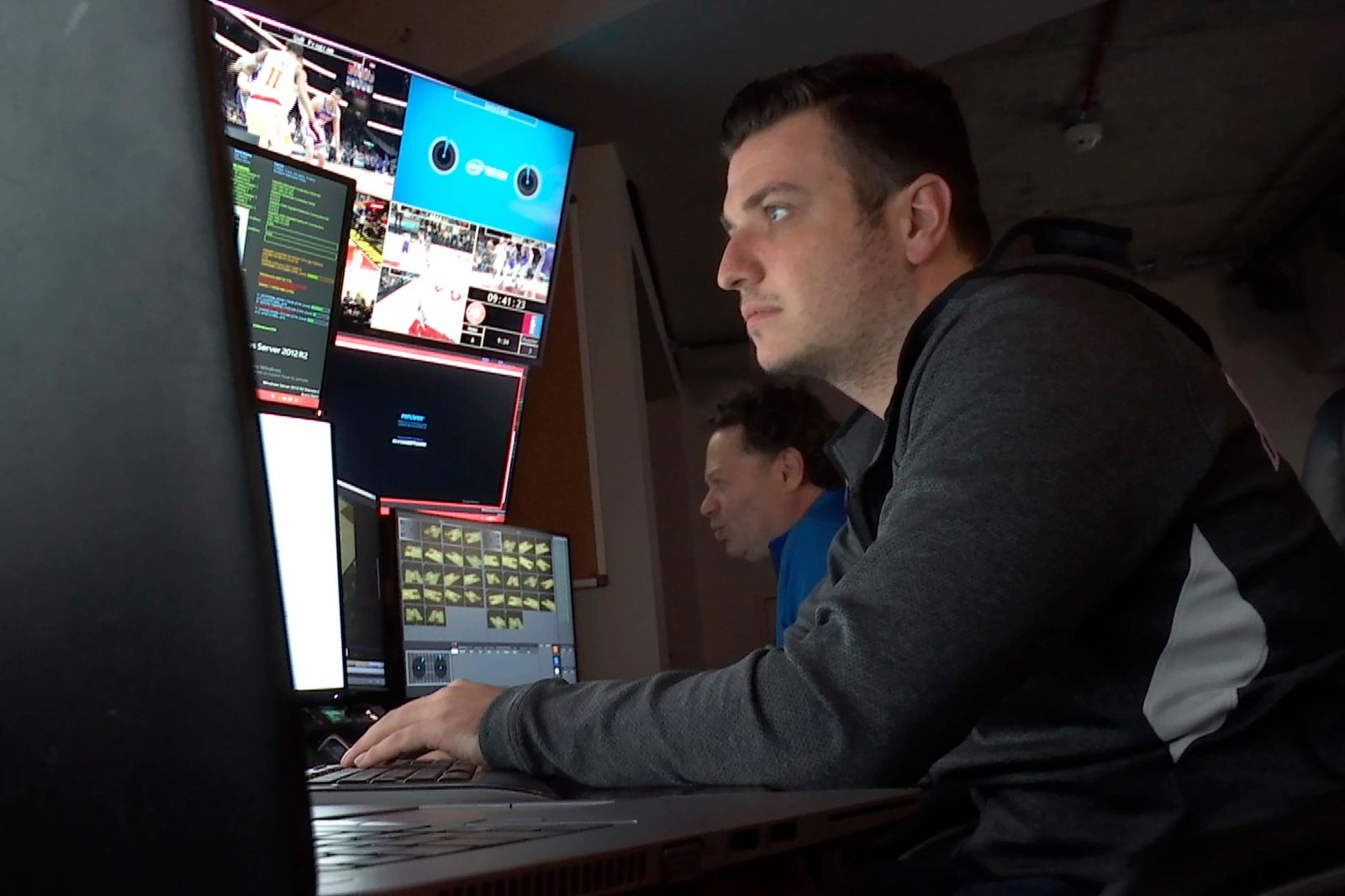In this Thursday, Nov. 7, 2019, photo taken from video, technicians monitor video feeds from 38 cameras placed around State Farm Arena in Atlanta in order to produce 3 dimensional video replays. The Atlanta Hawks Friday will become the fifth NBA team to unveil significant financial investments into new 360-degree replay technology designed to eventually give fans the power to change the way they see the game.  (AP Photo/Cody Jackson)
