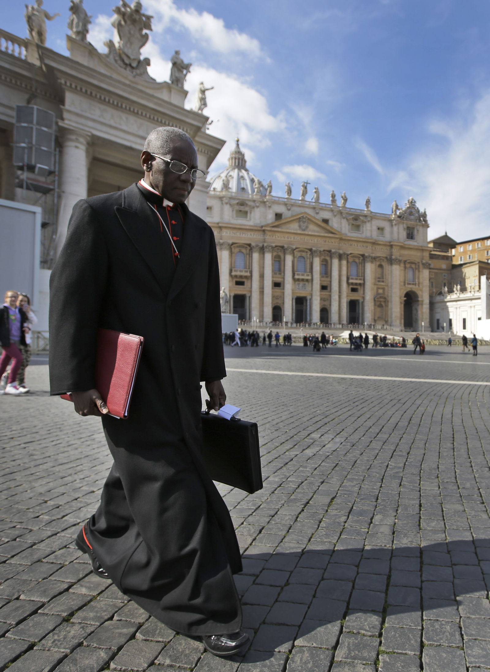 FILE - In this Monday, March 4, 2013 file photo, Cardinal Robert Sarah, of Guinea, walks in St. Peter's Square after attending a cardinals' meeting, at the Vatican.{ } (AP Photo/Andrew Medichini, File)