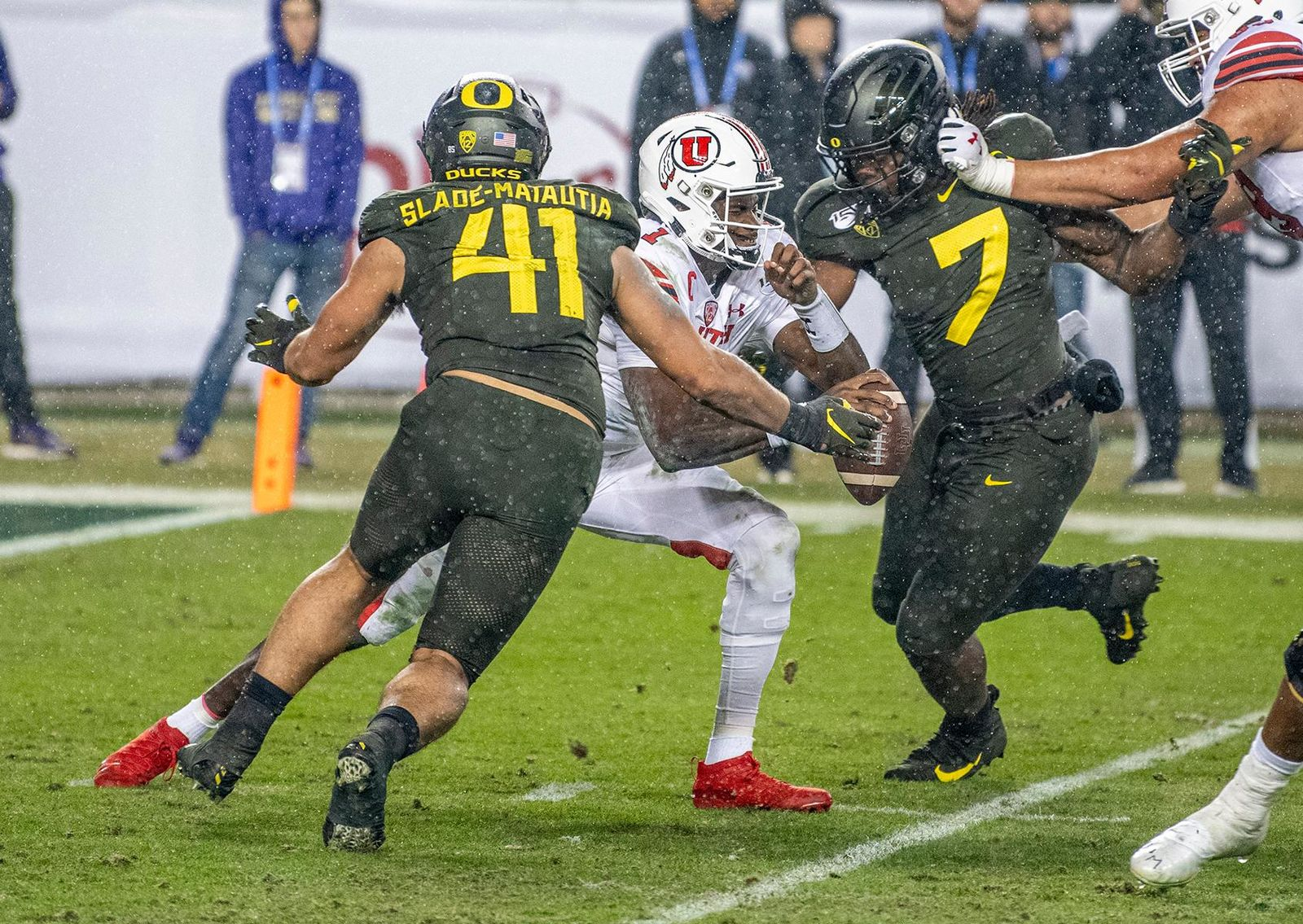 Oregon's middle linebacker Isaac Slade-Matautia, #41, and defensive end DJ Johnson, #7, sack Utah's quaterback Tyler Huntley, #1, for a loss of yards.  The University of Oregon Ducks defeated the University of Utah Utes 37-15 for the Pac 12 Championship Friday night at Levi's Stadium. Oregon's running back CJ Verdell, #7, rushed for 203 all-purpose yard along with three touchdowns for the night. Verdell was named the games M-V-P for his performace. Oregon's safey Brady Breeze, #25, contributed 9 tackles and one interception. Oregon's defensive end Kayvon Thibodeaux, #5, sacked Utah's quarterback Tyler Huntly, #1, for a total of three times. Oregon's quarterback Justin Herbert, #10, passed for 193 yards with one touchdown. The Oregon Ducks will represent the Pac 12 for the upcoming Rose Bowl game in the new year. Photo by Jeffrey Price