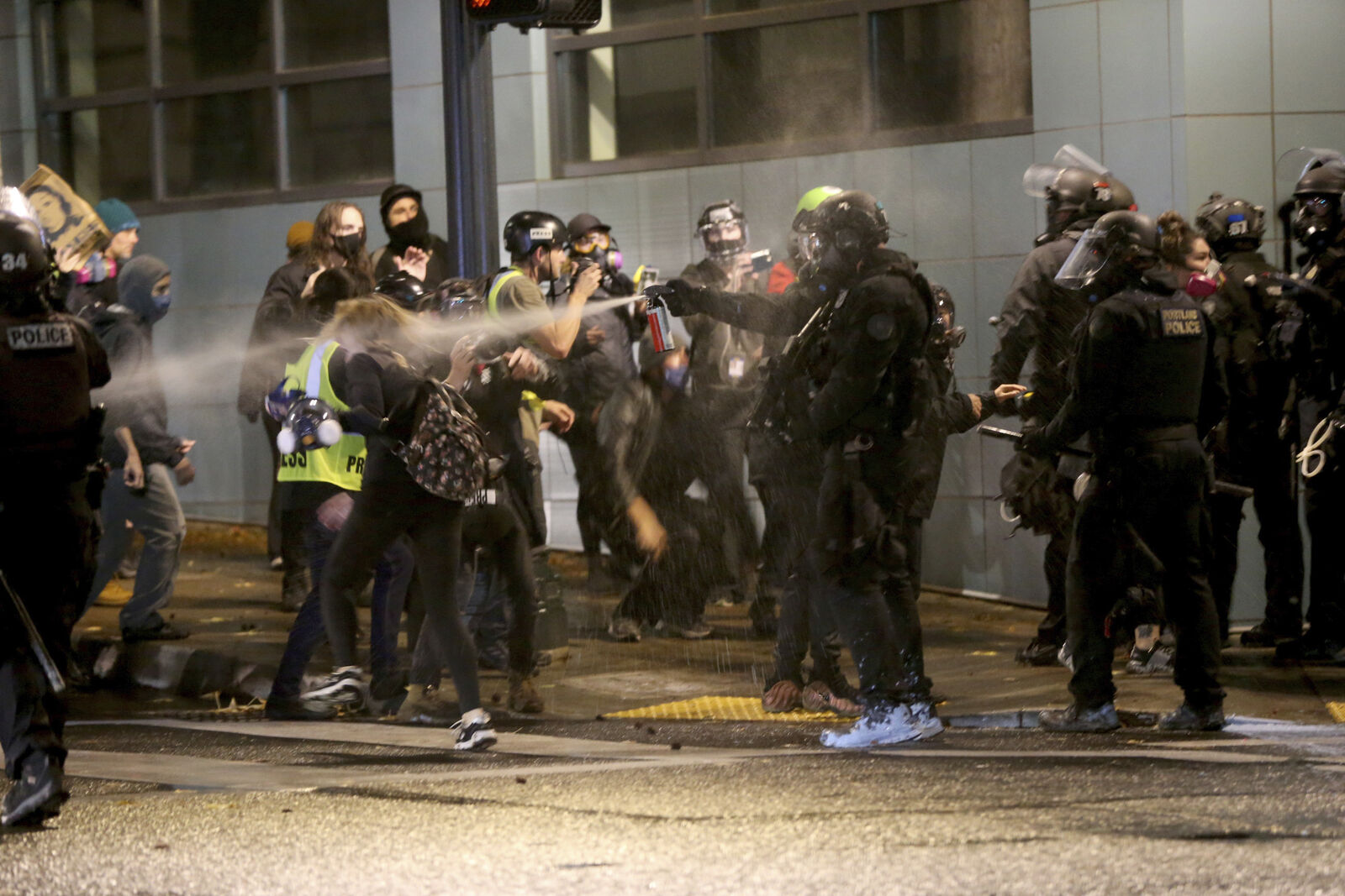 Protesters demanding the end of police violence against Black people are sprayed by police during a demonstration in Portland, Ore., on Wednesday, Sept. 23, 2020. (Mark Graves/The Oregonian via AP)