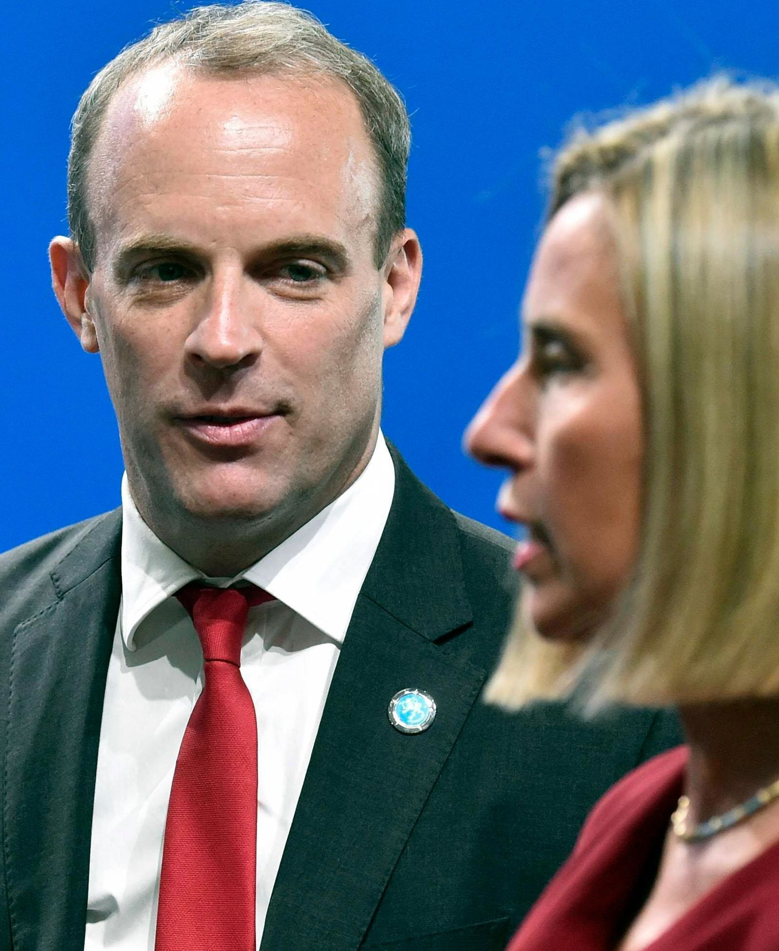 British Foreign Secretary Dominic Raab, left, speaks with European Union Foreign Policy Chief Federica Mogherini during the Informal Meeting of EU Foreign Ministers in Helsinki, Finland, Thursday Aug. 29, 2019. (Jussi Nukari/Lehtikuva via AP)