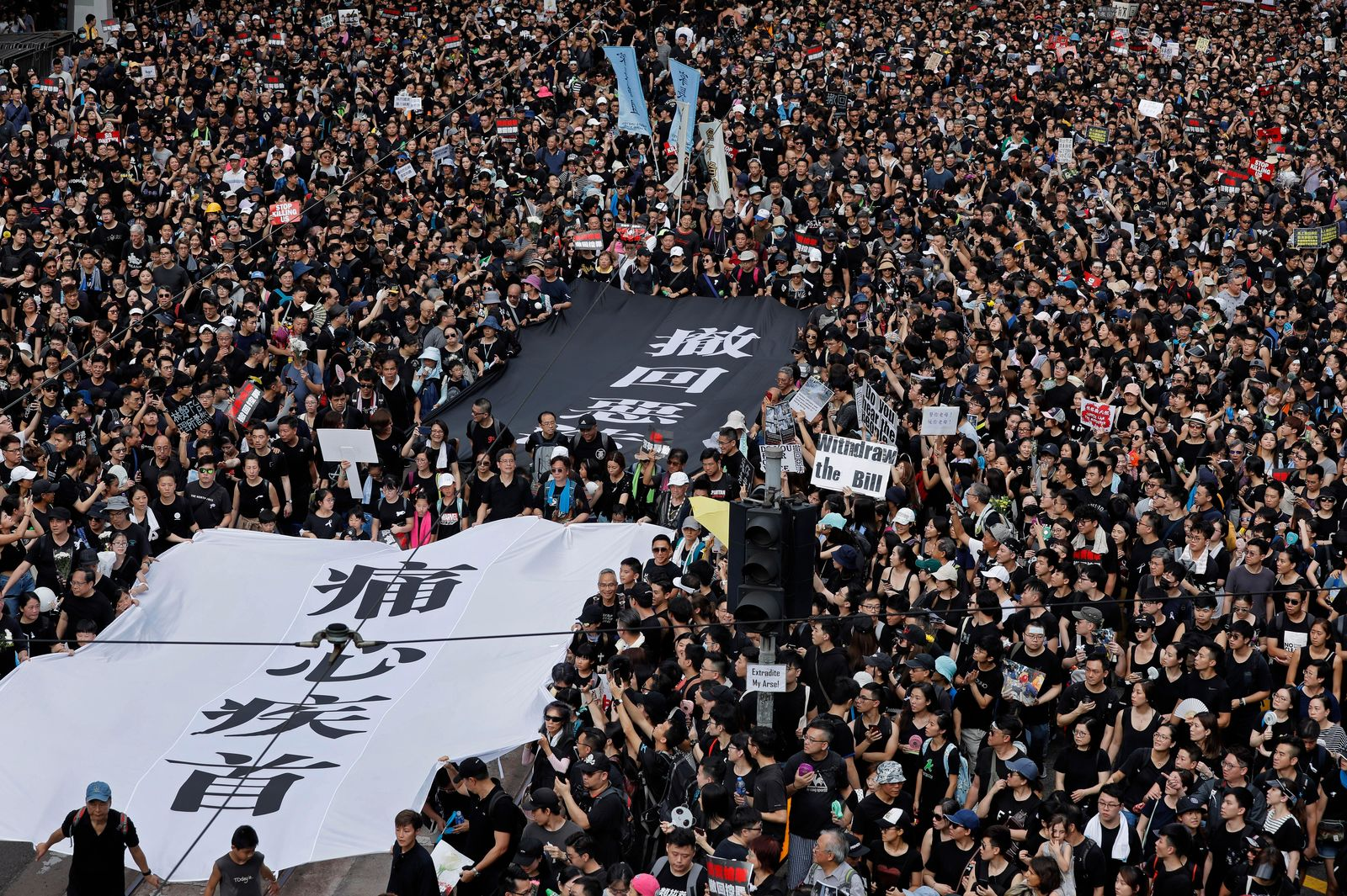 "Protesters carry a huge banner that reads ""Our hearts are torn to pieces. Withdraw the monstrous bill"" as they march on the streets against an extradition bill in Hong Kong on Sunday, June 16, 201(AP Photo/Vincent Yu)"