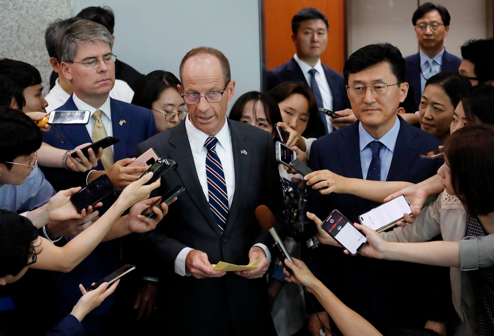 David Stilwell, center left, U.S. Assistant Secretary of State for the Bureau of East Asian and Pacific Affairs, speaks as South Korea's Deputy Foreign Minister for Political Affairs Yoon Soon-gu, center right, listens after a meeting with South Korean Foreign Minister Kang Kyung-wha at the foreign ministry in Seoul, South Korea, Wednesday, July 17, 2019. (AP Photo/Ahn Young-joon. Pool)