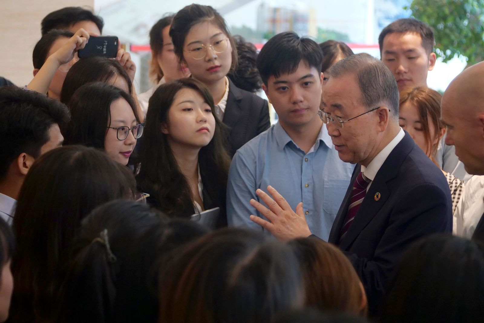 Former U.N. Secretary-General Ban Ki-moon, fourth right, speaks with attendees on the sidelines of a press conference for the release of a report on adapting to climate change in Beijing, Tuesday, Sept. 10, 2019. A group of leaders from business, politics and science called Monday for a massive investment in adapting to climate change over the next decade, arguing it would reap significant returns as countries avoid catastrophic losses and boost their economies. (AP Photo/Sam McNeil)