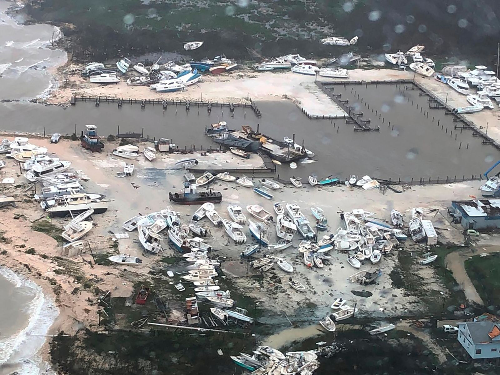 In this Monday, Sept. 2, 2019 photo released by the U.S. Coast Guard Station Clearwater, boats litter the area around marina in the Bahamas after they were tossed around by Hurricane Dorian.{ } (U.S. Coast Guard Station Clearwater via AP)