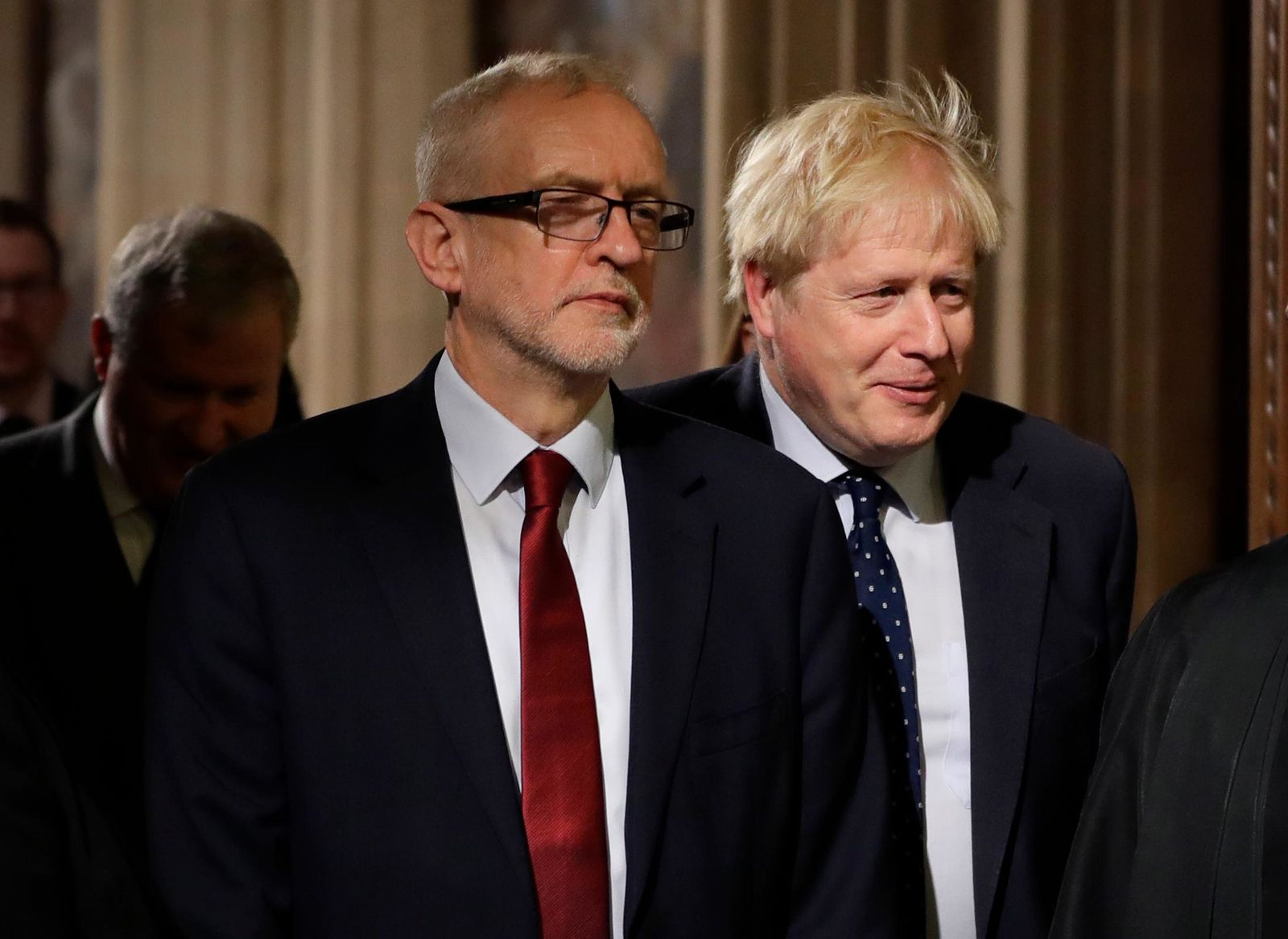 Britain's Prime Minister Boris Johnson, right, and opposition Labour Party Leader Jeremy Corbyn, left, walk through the Commons Members Lobby in Parliament, London, Monday, Oct. 14, 2019. Britain's parliament returns from a brief break for the State Opening of Parliament. (AP Photo/Kirsty Wigglesworth, pool)