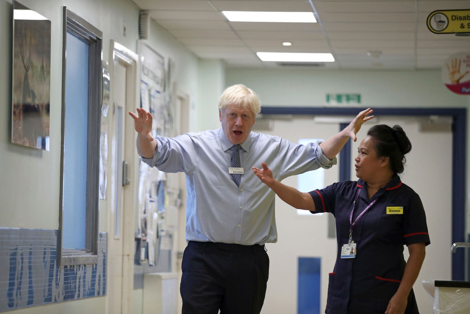 Britain's Prime Minister Boris Johnson visits Whipps Cross University Hospital in Leytonstone, east London, Wednesday Sept. 18, 2019. (Yui Mok/Pool via AP)