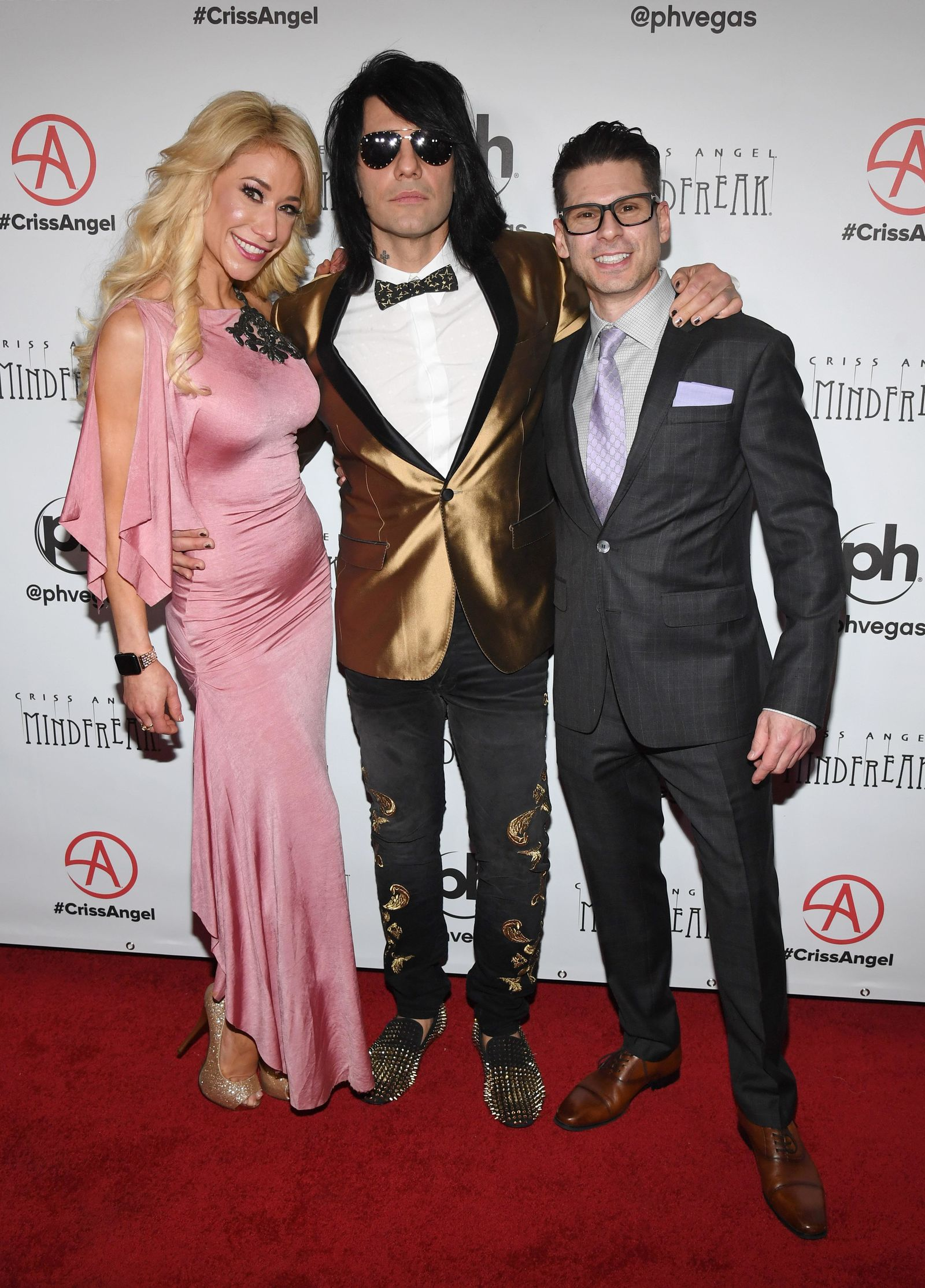 "LAS VEGAS, NEVADA - JANUARY 19:  (L-R) Violinist Lydia Ansel, illusionist Criss Angel and comedian/magician Mike Hammer attend the grand opening of ""Criss Angel MINDFREAK"" at Planet Hollywood Resort & Casino on January 19, 2019 in Las Vegas, Nevada.  (Photo by Ethan Miller/Getty Images for Planet Hollywood Resort & Casino)"