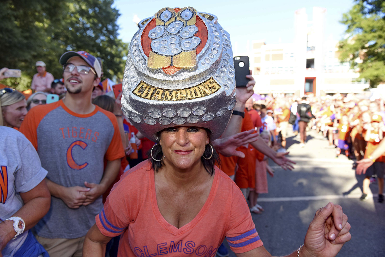 Clemson fan Theresa Gardner shows her support wearing an oversized championship ring before the team's NCAA college football game against Georgia Tech Thursday, Aug. 29, 2019, in Clemson, S.C. (AP Photo/Richard Shiro)