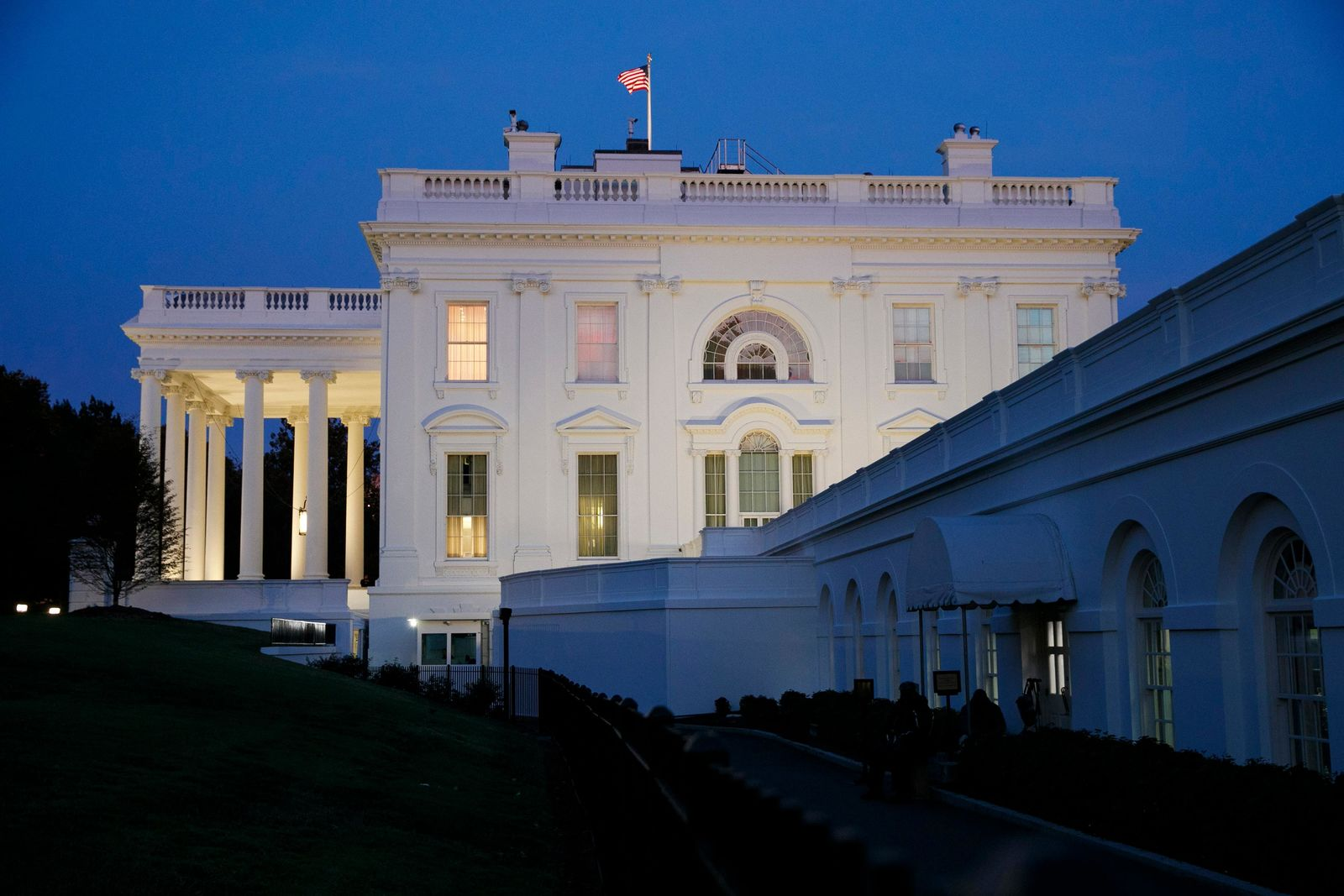 The White House is seen at dusk as members of the media wait for comment from Charlotte Charles and Tim Dunn, the parents of Harry Dunn, Tuesday, Oct. 15, 2019, at the White House in Washington. AP Photo/Jacquelyn Martin)