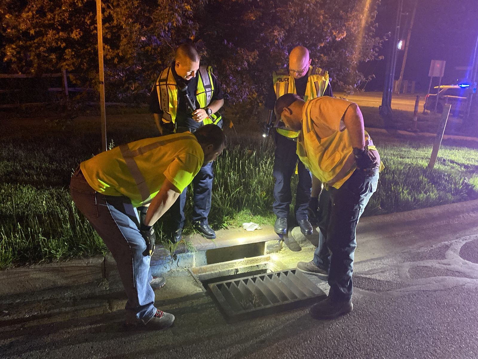 Westerville police and members of the Westerville Service Department rescued three ducklings that were stuck in a storm drain Wednesday night. (Westerville Police Department)