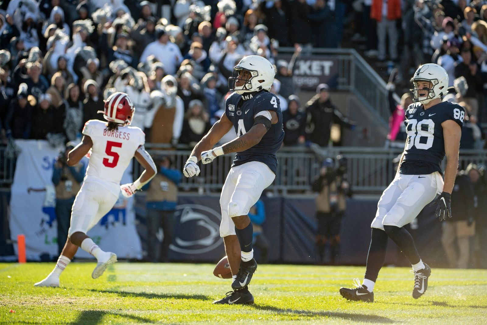 Penn State running back Journey Brown (4) celebrates in front of Indiana defensive back Juwan Burgess (5) after scoring on a 35-yard touchdown in the third quarter of an NCAA college football game in State College, Pa., on Saturday, Nov.16, 2019. Penn State defeated 34-27. (AP Photo/Barry Reeger)