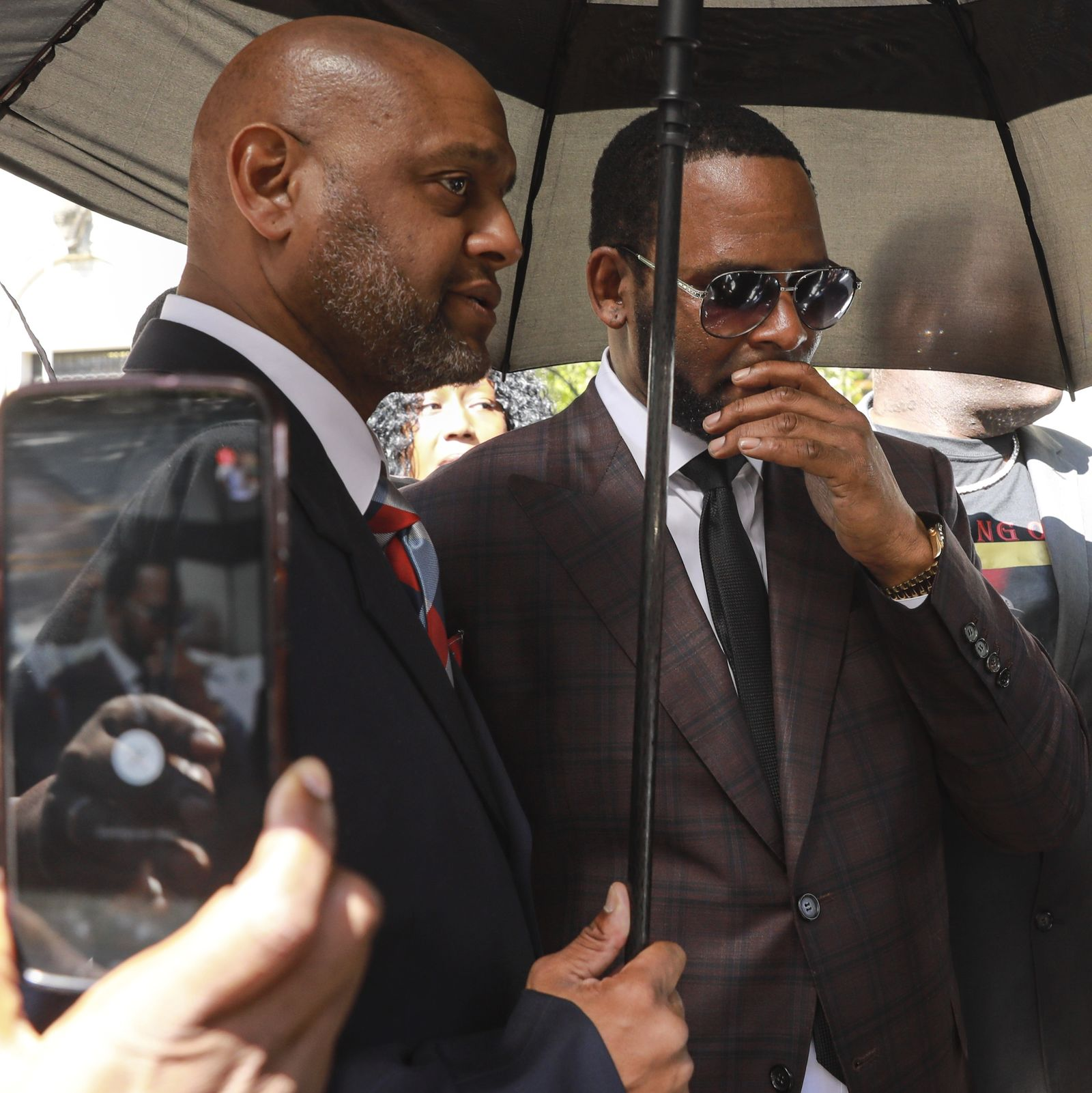 Musician R. Kelly, right, departs from the Leighton Criminal Court building after a status hearing in his criminal sexual abuse trial Wednesday, June 26, 2019 in Chicago. (AP Photo/Amr Alfiky)