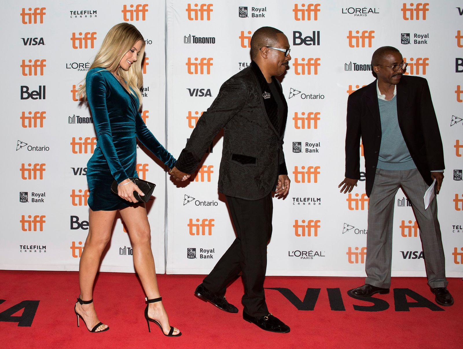 "Actor Eddie Murphy and his girlfriend Paige Butcher pose for photographs on the red carpet for the new movie ""Dolemite Is My Name"" in Toronto, on Saturday, Sept. 7, 2019. (Nathan Denette/The Canadian Press via AP)"