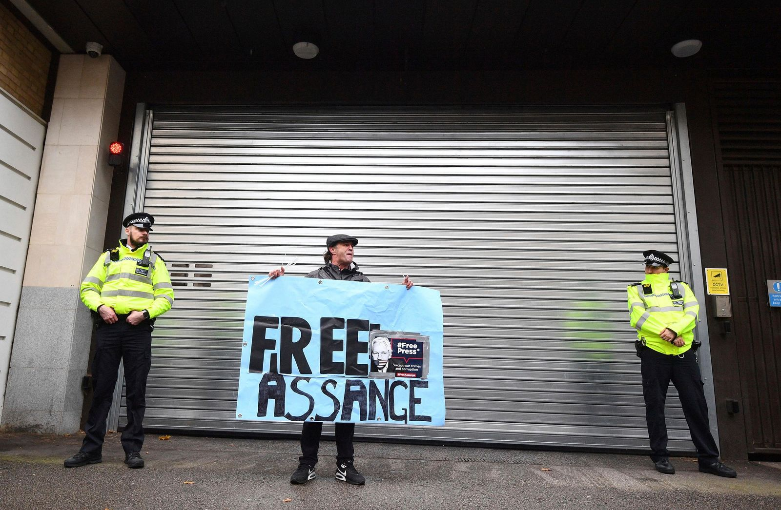 A supporters of Wikileaks founder Julian Assange demonstrate oustide Westminster Magistrates' Court in London where Assange is expected to appear as he fights extradition to the United States on charges of conspiring to hack into a Pentagon computer, in London, Monday, Oct, 21, 2019. (Victoria Jones/PA via AP)