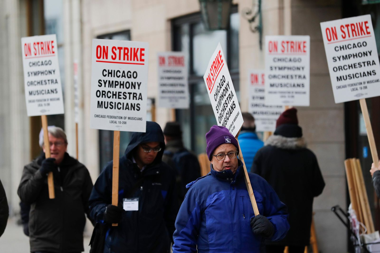 Striking Chicago Symphony Orchestra musicians walk the picket line after a lack of progress in contract talks outside of Symphony Center in Chicago on Monday, March 11, 2019. (Jose M. Osorio/Chicago Tribune via AP)