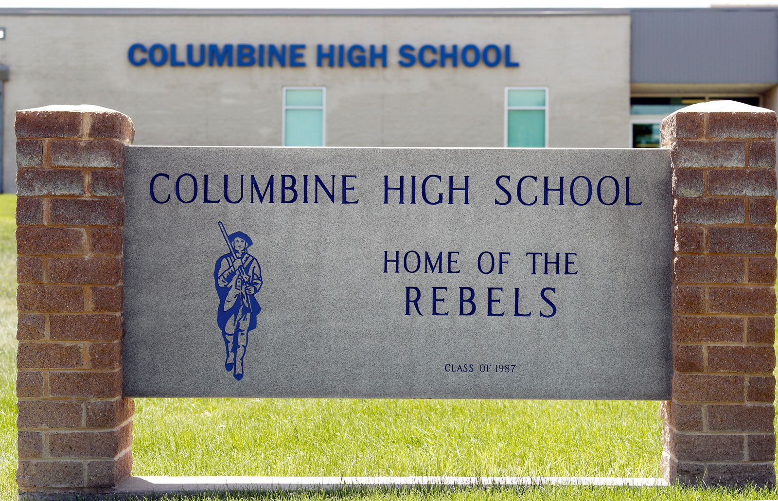 Signs outside Columbine High School are photographed, Thursday, June 13, 2019, in Littleton, Colo. The school district is considering the demolition of Columbine, the scene of a mass assault more than 20 years ago, and rebuilding the current school. (AP Photo/David Zalubowski)